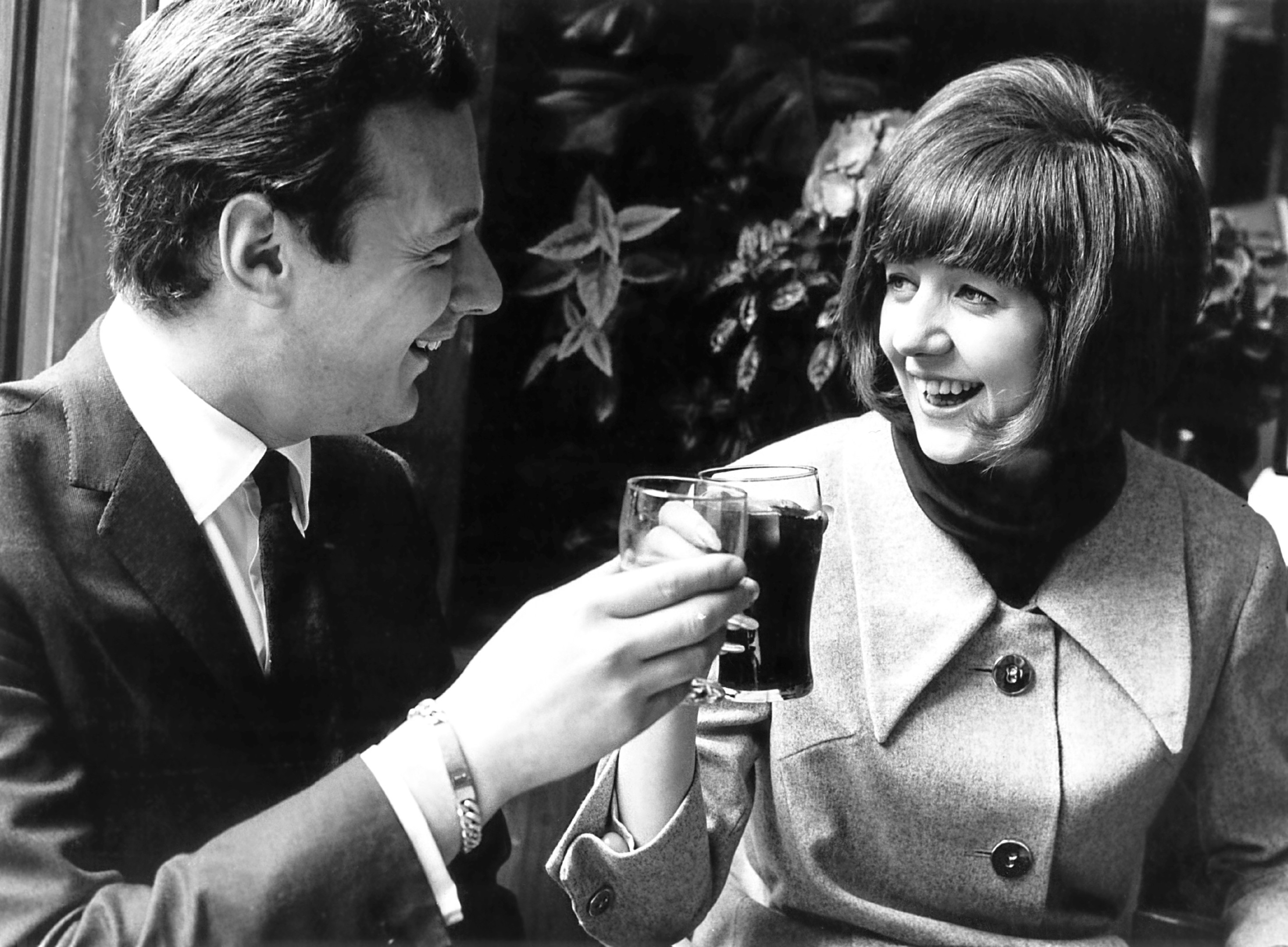 Cilla Black with her manager Brian Epstein, 1964.  (Evening Standard/Hulton Archive/Getty Images)