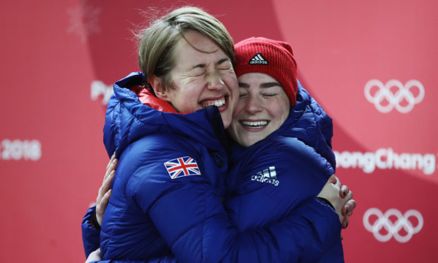 Gold medal winner Lizzy Yarnold of Great Britain and bronze medalist Laura Deas of Great Britain celebrate following the Women's Skeleton on day eight of the PyeongChang 2018 Winter Olympic Games at Olympic Sliding Centre (Clive Mason/Getty Images)