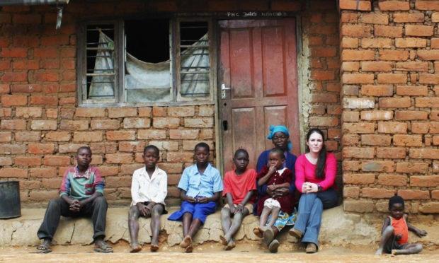 Sandi Thom accompanied by Lucy Maluwa, and some of her grandchildren, in Malawi, southern Africa. (Edlon Chagara/Oxfam/PA Wire)