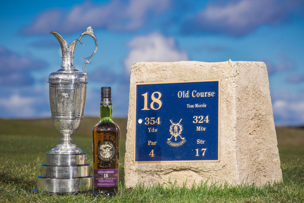 4.The Claret Jug and the Loch Lomond 18 Year Old Single Malt Scotch Whisky, photographed at the 18th tee at St Andrews as part of the partnership between Loch Lomond Group and The Open