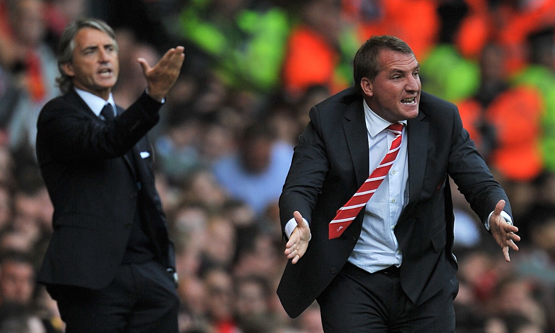Brendan Rodgers will be up against Roberto Mancini again on Thursday night (PA)