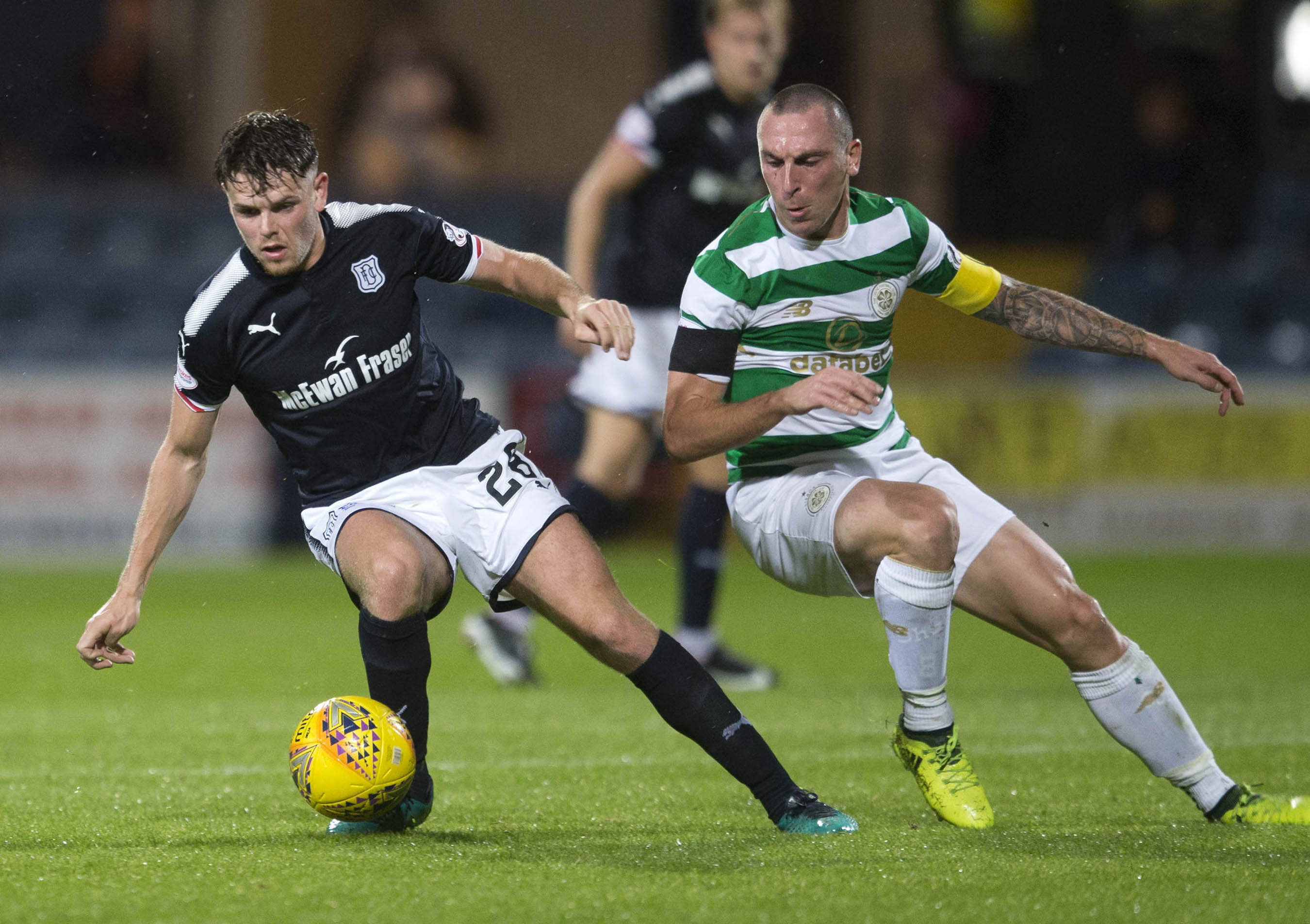 Dundee's Lewis Spence (left) and Celtic's Scott Brown (right) (Jeff Holmes/PA Wire)
