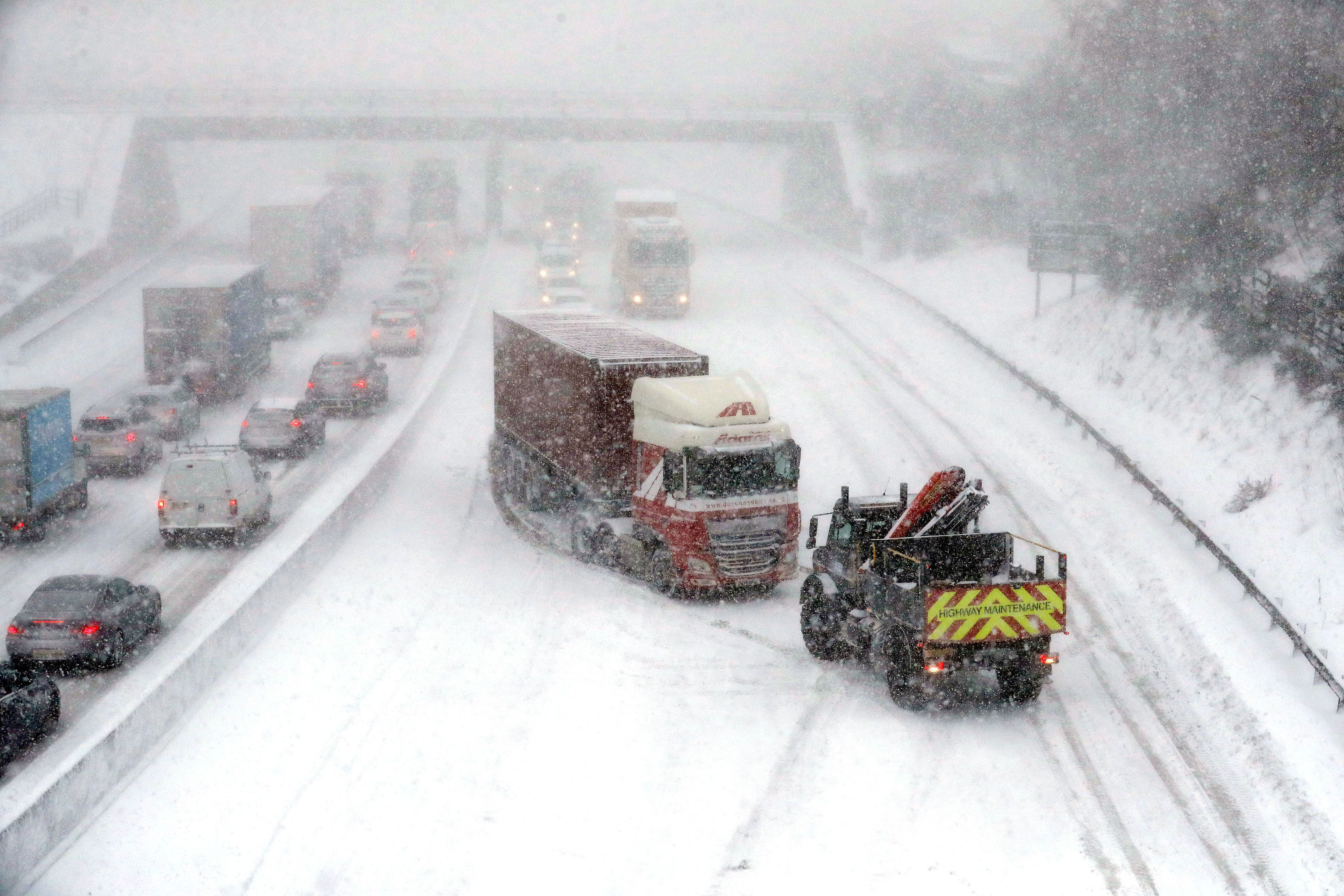 Drivers trapped by snow spend night in vehicles