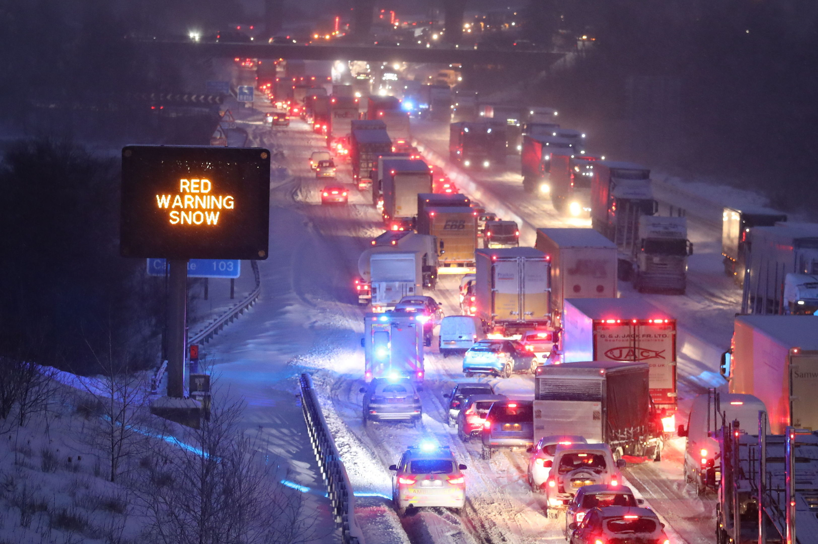 Emergency vehicles manoeuvre past stationary traffic on the M80 at Haggs (Andrew Milligan/PA)