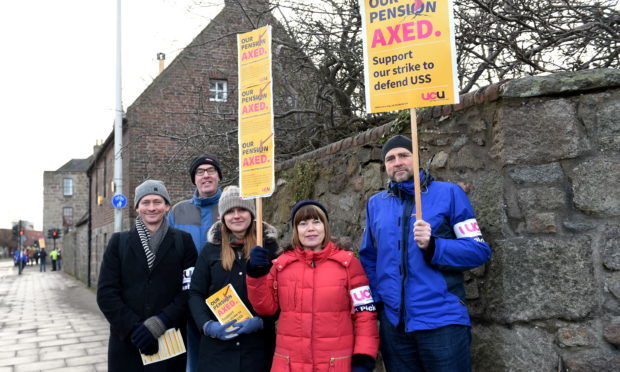 Picketers outside Aberdeen University. They are picketing over a nationwide planned pension change by Universities UK (UUK). (Darrell Benns)