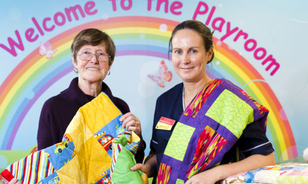 Catherine Waterson and others have been making quilts for the children on the cancer ward Schiehallion at Yorkhill the Royal Hospital for Sick Children in Glasgow - Catherine left with Emma Summerville (Senior Charge Nurse) (Jamie Williamson)