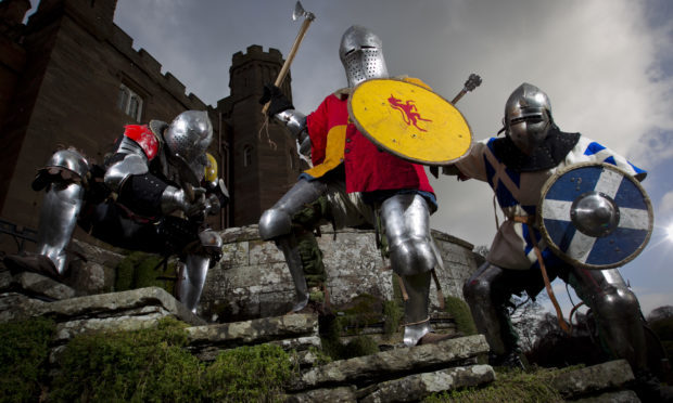 Members of the Scottish Knight League, in training at Scone Palace, as they will be competing at the International Medievel Combat Federation World Championships at Scone Palace in May this year. (Ryan Fitzpatrick, Euan Campbell (captain), Ralph Campbell-Smith) (Andrew Cawley/DC Thomson)