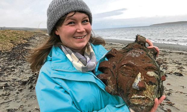 Kerry Leitch who found a sandstone head on the beach in Orkney. (Orcadian)