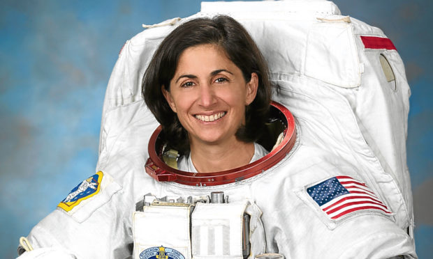 Official Portrait of NASA Astronaut Nicole Stott in an EUM. (Robert Markowitz)
