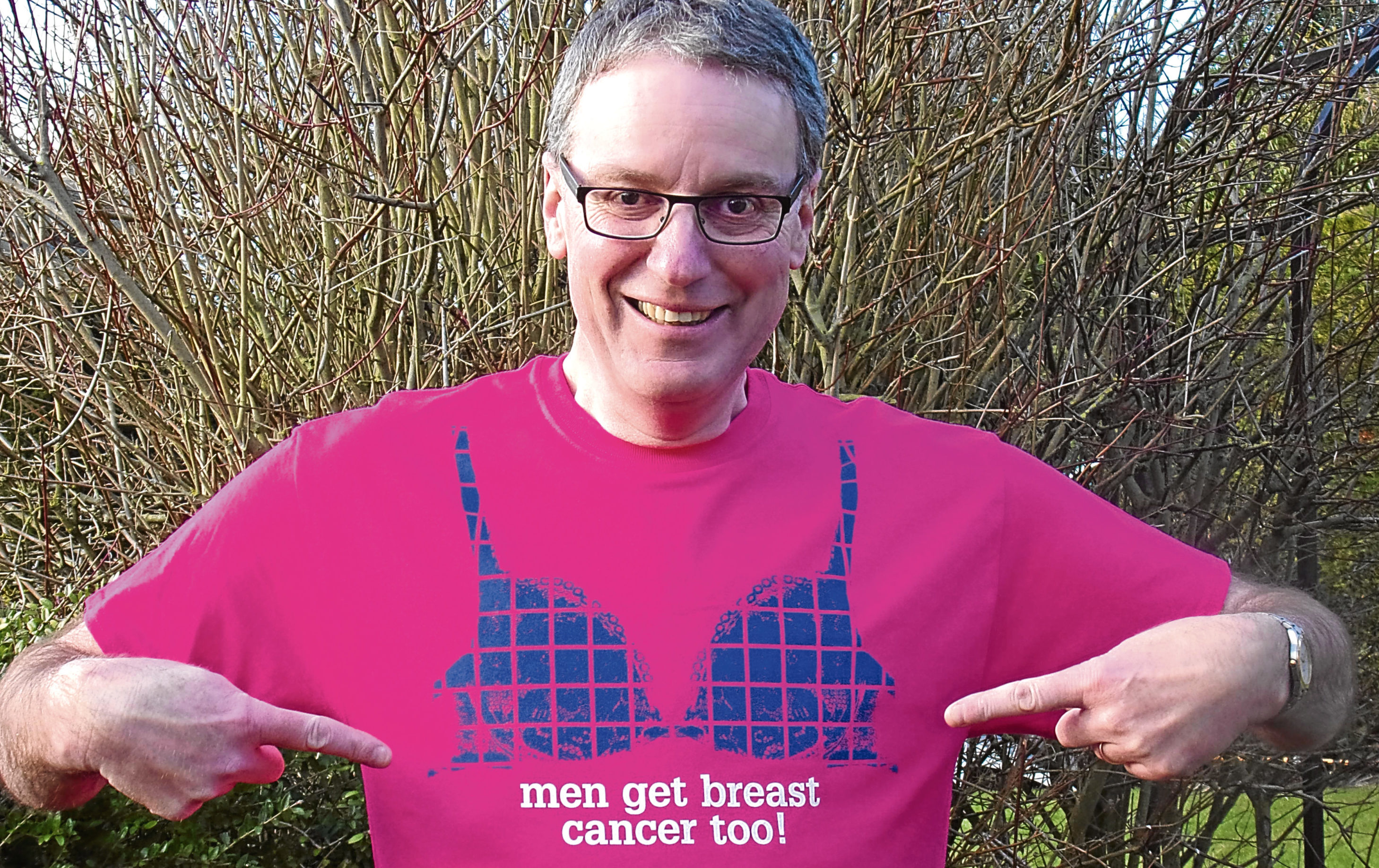 Breast cancer survivor Giles Cooper is delighted with his new T-shirt
