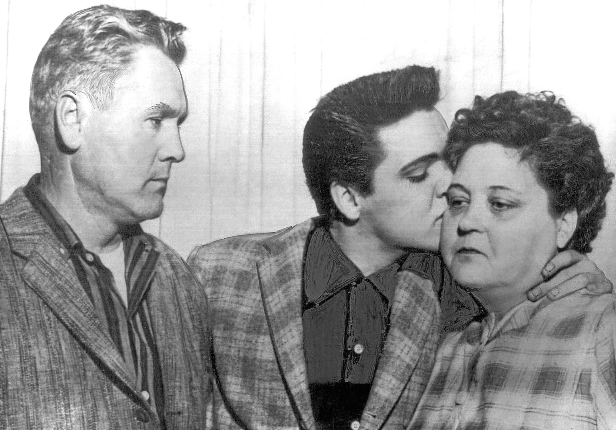 Elvis says goodbye to his dad, Vernon, and beloved mum, Gladys, as he prepares to enter the military (Everett Collection Inc / Alamy)