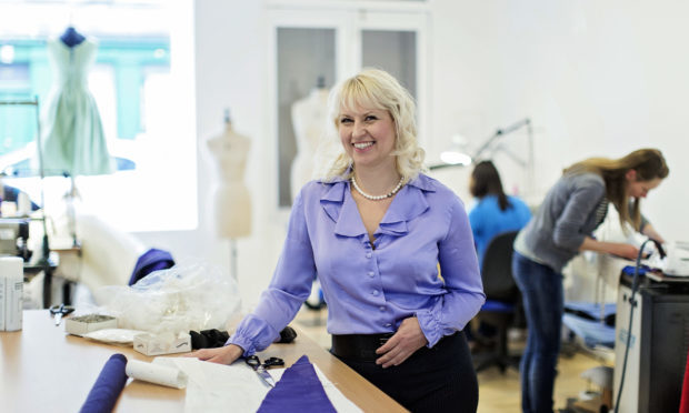 Mette Baillie, who suffered from breast cancer, but changed her medical regime so that she could continue to make wedding dresses. (Paul Raeburn)
