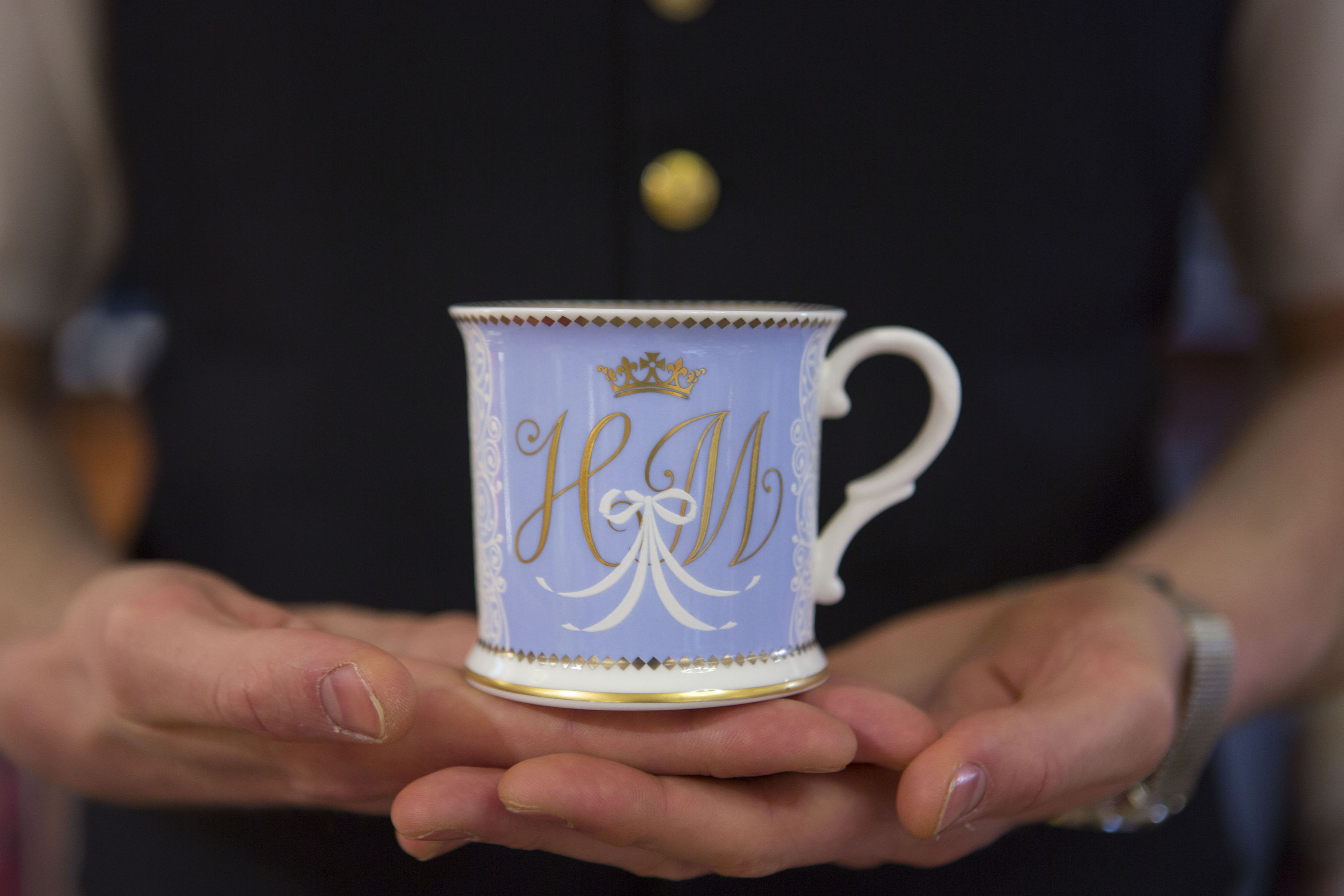 A tea cup bearing the initials H and M which forms part of the new official range of china celebrating the future marriage of Prince Harry and Meghan Markle (Rick Findler/PA Wire)