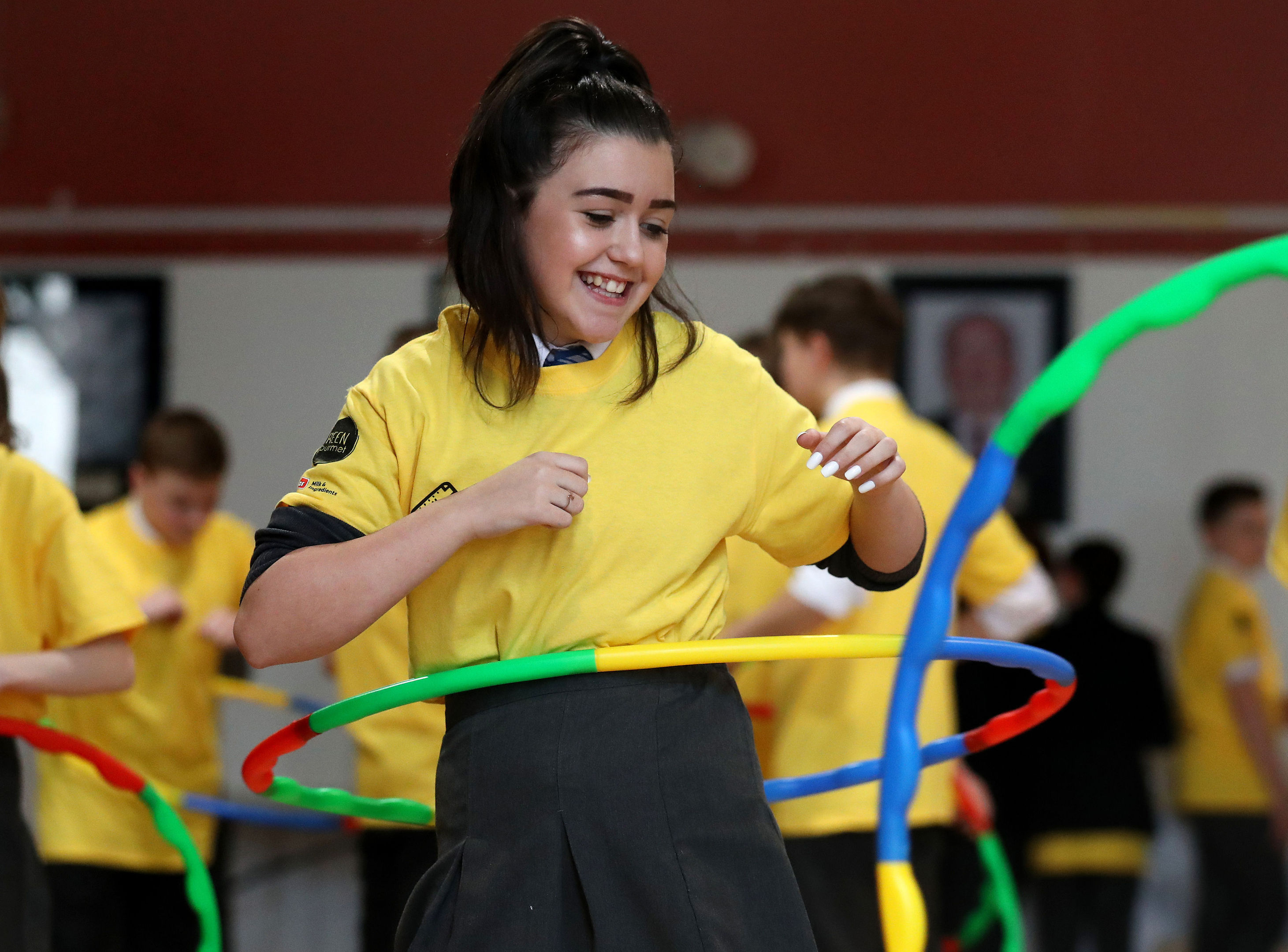 Bryonney Wilson-Gray joins her classmates in hula hoop exercise at  Holyrood Secondary School in Glasgow (Andrew Milligan/PA Wire)
