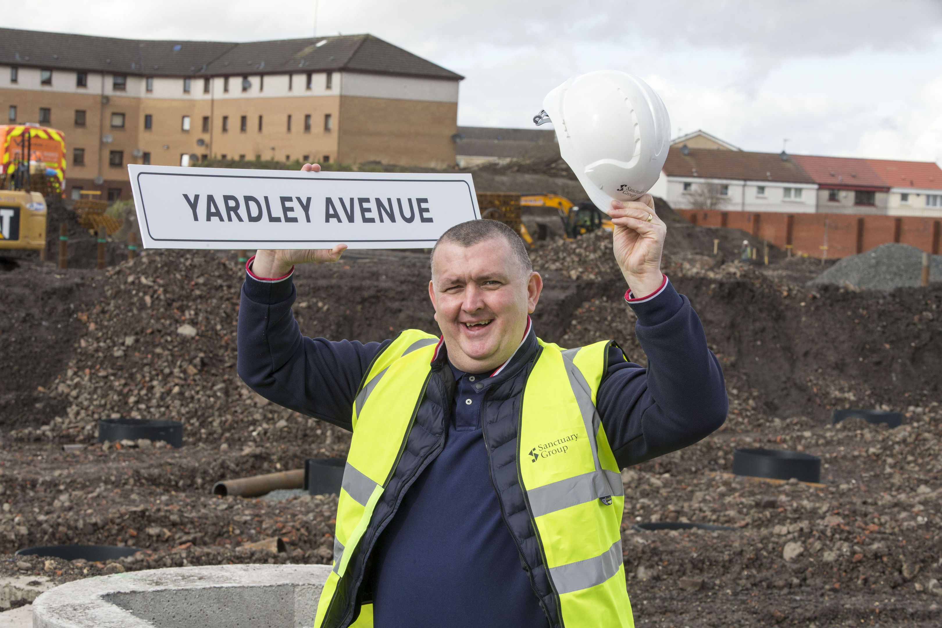 Mark Yardley holding a sign for a street which has been named in his honour (Jeff Holmes/PA Wire)