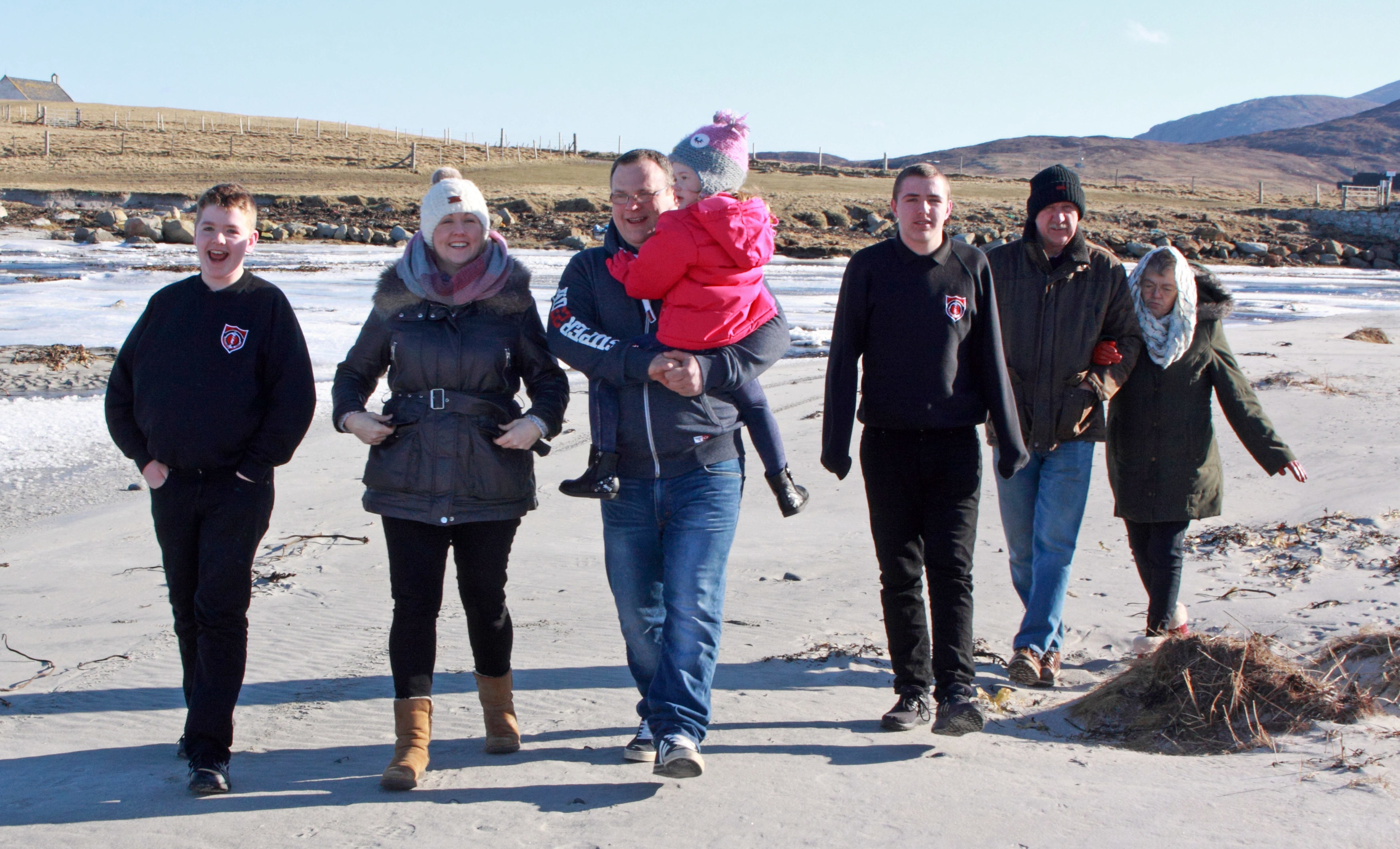Sarah MacMillan, second left, with sons Bryn, far left, and Seth, third right, husband Angus holding daughter Isla, and parents Keith and Kath Bramley (Iain Smith)
