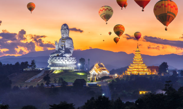 Colorful hot air balloons flying over Wat Huay Pla Kang (Getty Images/iStock)