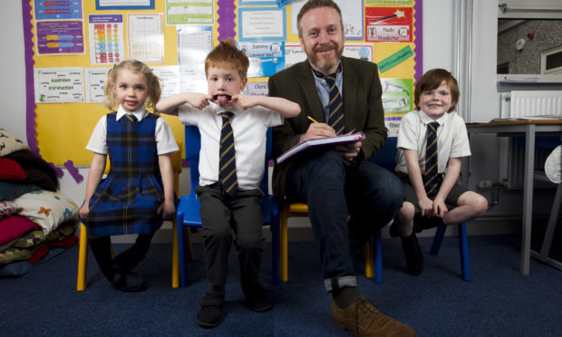 Writer Paul English meets, l-r, Anna Donaldson, Rory Bothwick, and David Wright as he visits his old primary school last week (Andrew Cawley / DC Thomson)