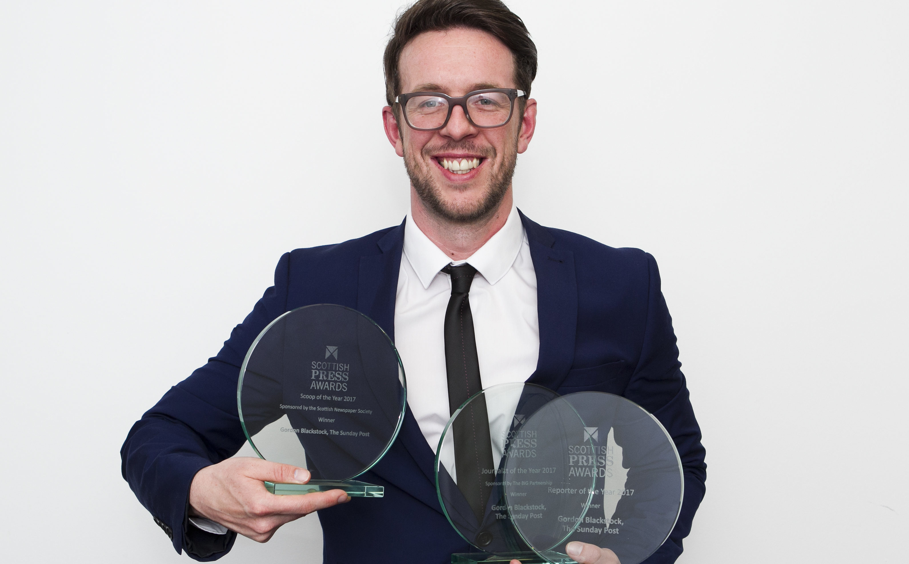 Our reporter Gordon Blackstock holding his three  Scottish Press Awards (Andrew Cawley)