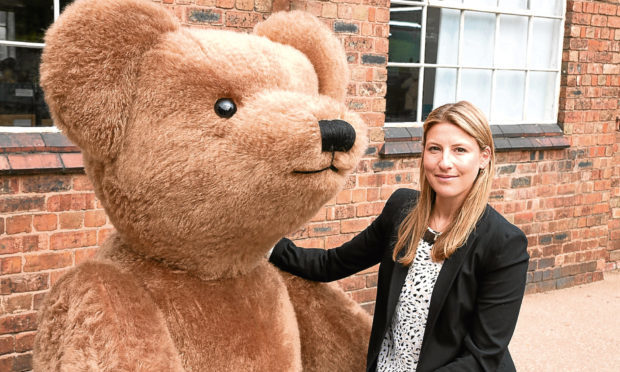 Sarah Holmes with Giant Merrythought Bear