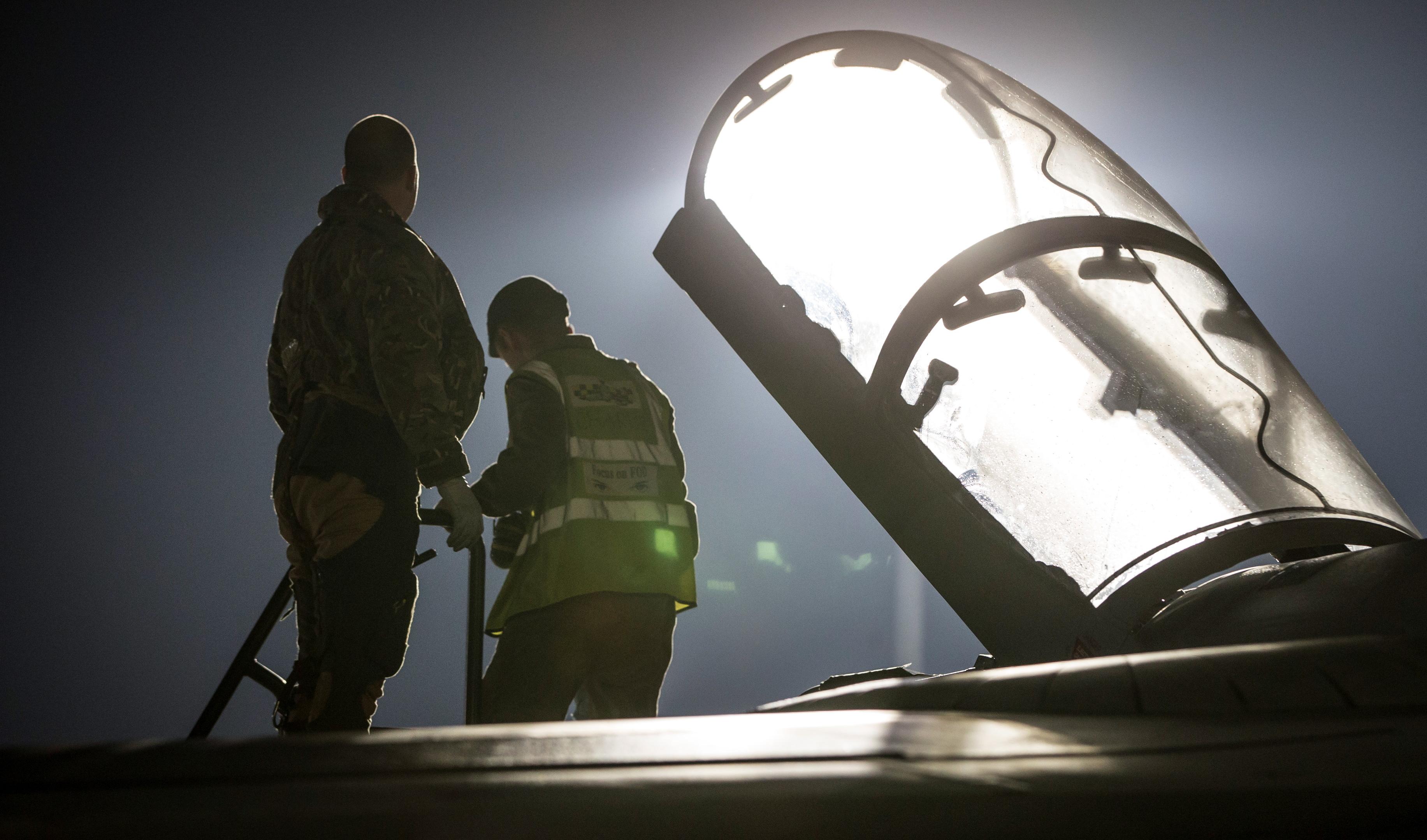 Ground crew prepare a British jet (MOD)