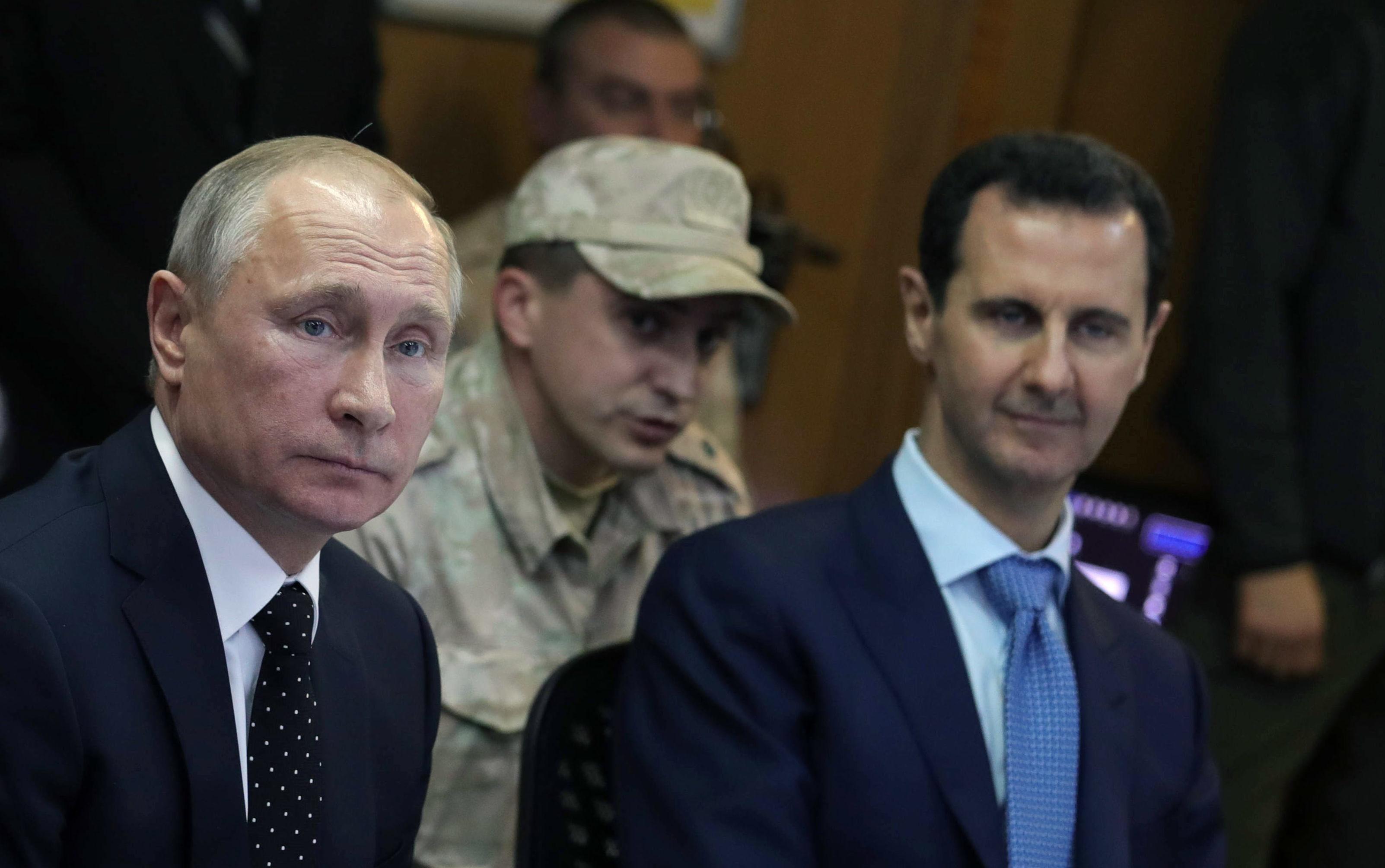 Vladimir Putin and Bashar al-Assad (Mikhail KlimentyevTASS via Getty Images)