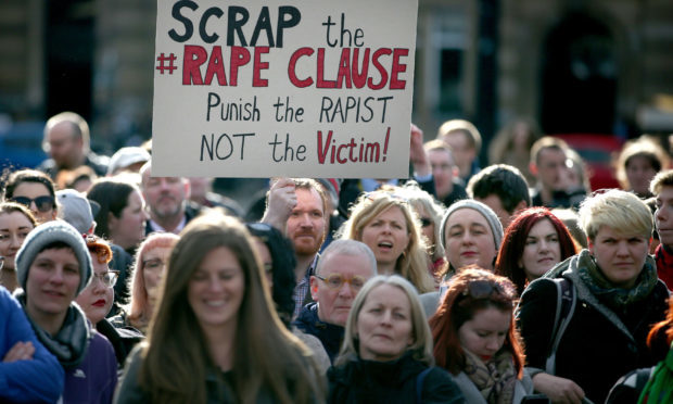 "Campaigners protest in George Square, Glasgow, against the UK Government's so-called ""rape clause"" for tax credits. (Jane Barlow/PA Wire)"