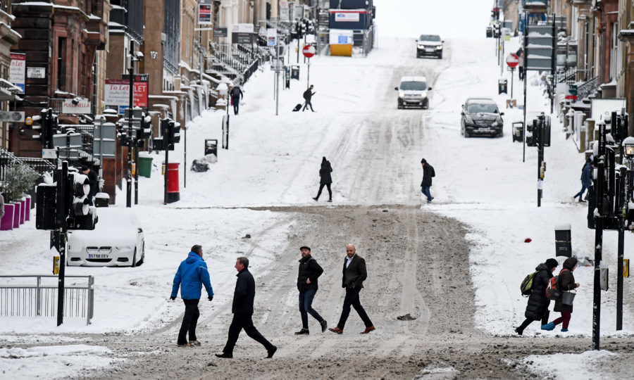 Members of the public make their way across West George Street on February 28, in Glasgow, Scotland. Freezing weather conditions dubbed the 'Beast from the East' bring snow and sub-zero temperatures to the UK (Jeff J Mitchell/Getty Images)