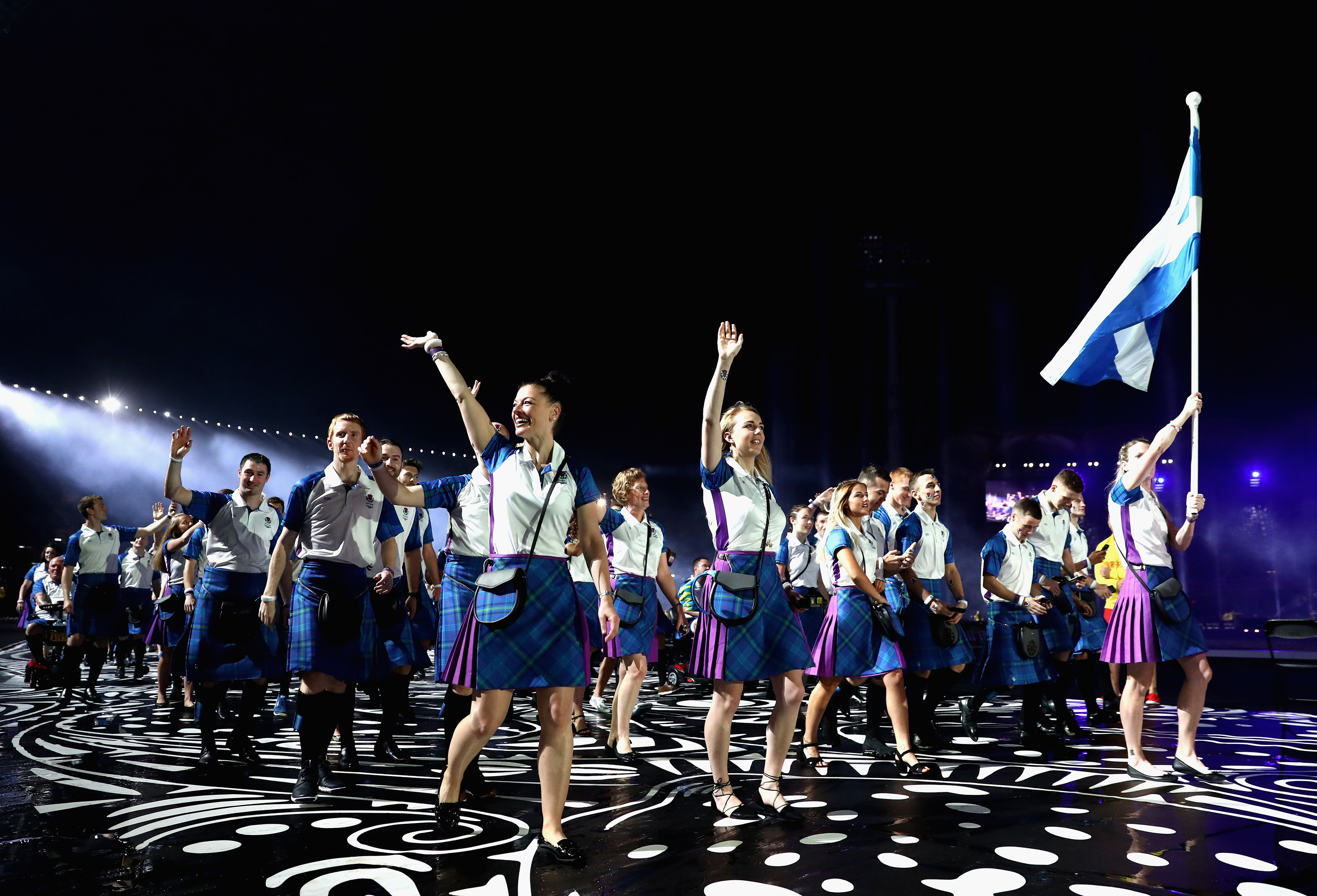 Flag bearer Eilidh Doyle arrives with Team Scotland  (Ryan Pierse/Getty Images)