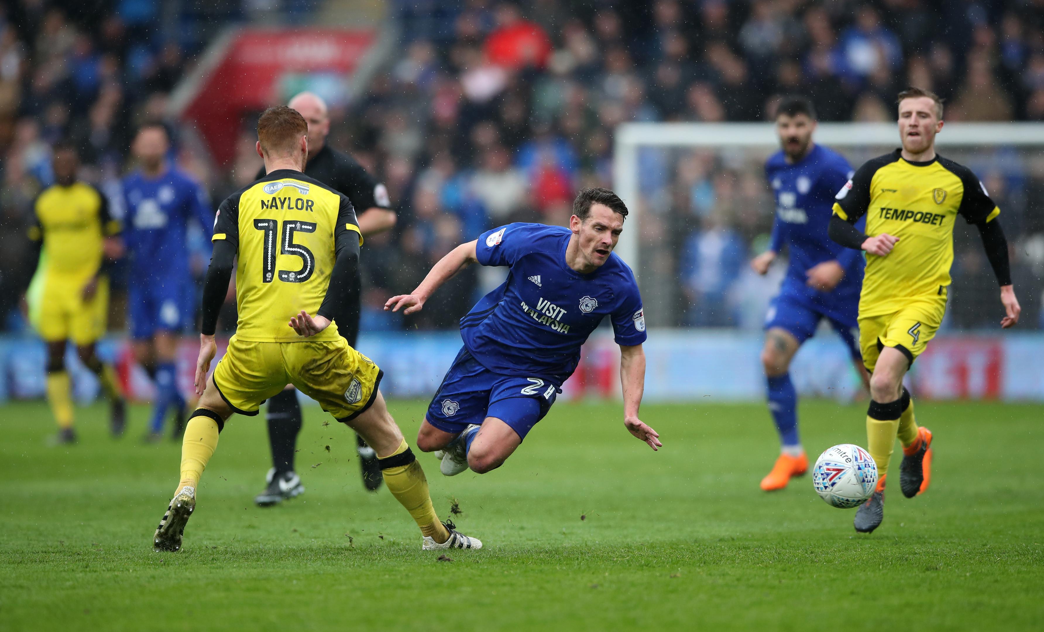 Burton Albion's Tom Naylor (left) challenges Cardiff City's Craig Bryson (PA)