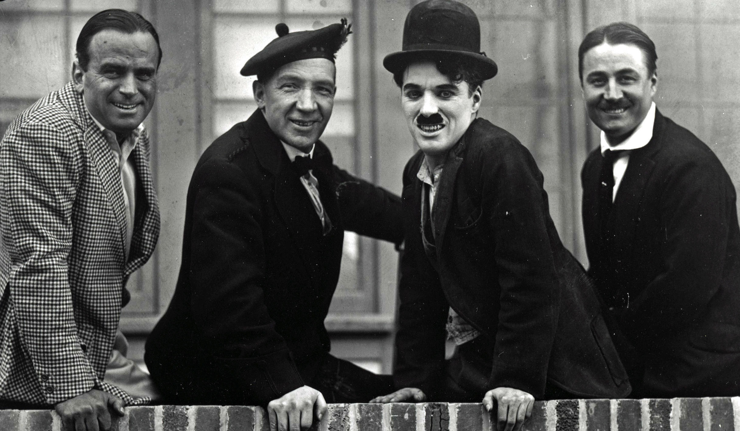 Sir Harry Lauder (second right) with Sir Charlie Chaplin (second left), as a rare screening of the moment they met on film is to be shown at a new comedy film festival (Roy Export Company/PA Wire)