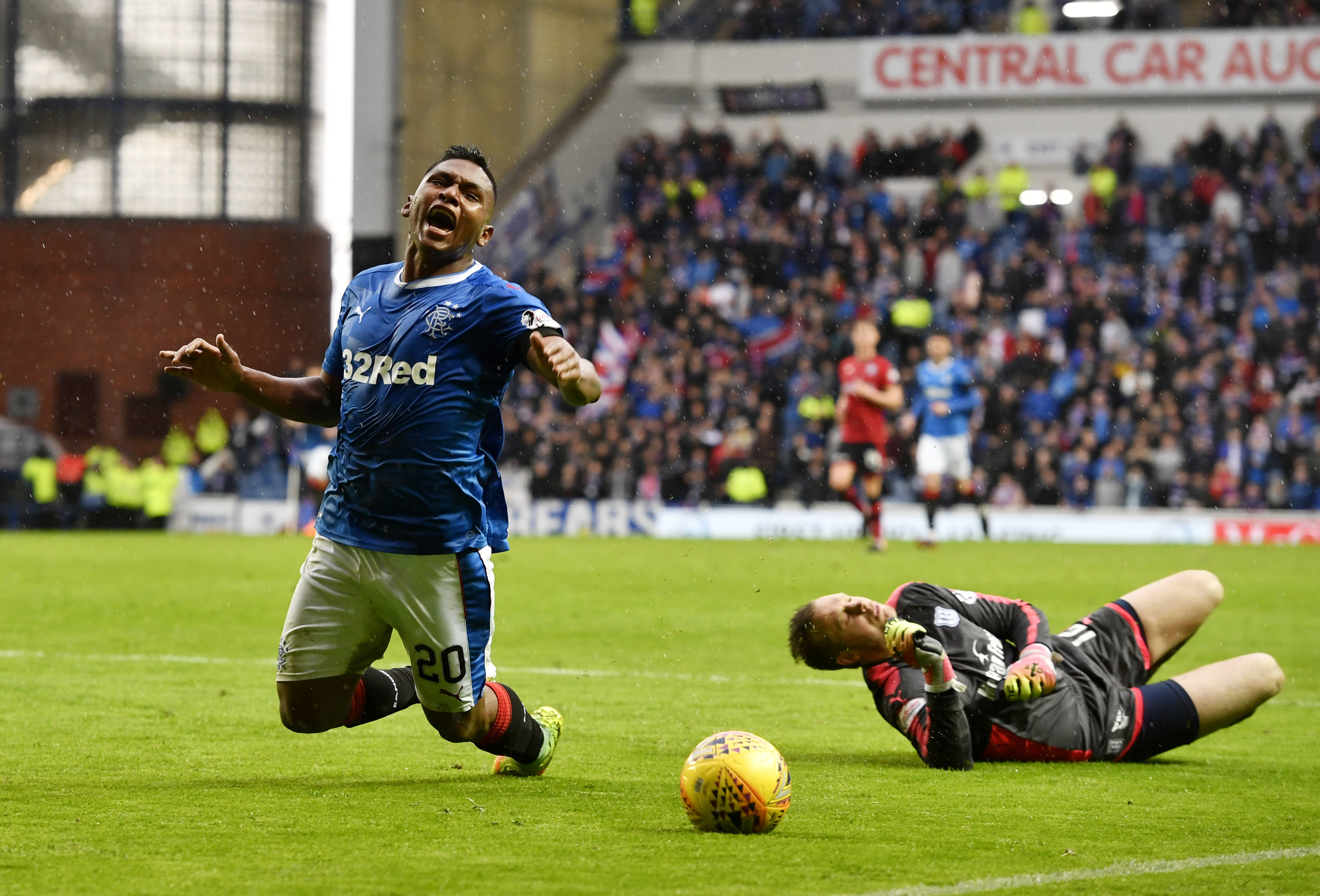 Rangers' Alfredo Morelos goes down after clashing with Dundee's Elliot Parish (SNS Group / Rob Casey)