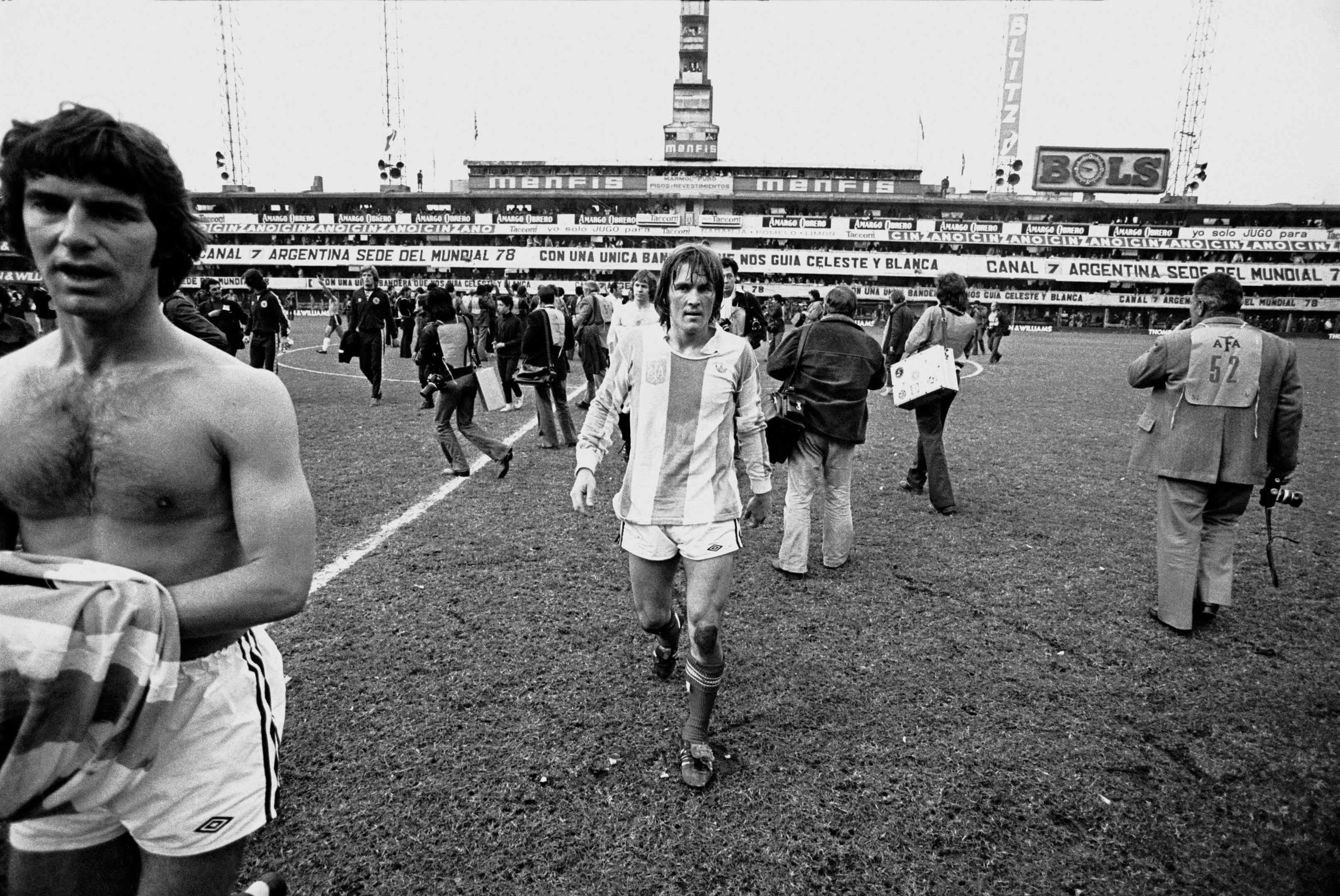 Kenny Dalglish, complete with Argentina top, comes off the pitch after a torrid friendly in Buenos Aires in 1977. Team-mate Martin Buchan of Manchester United is on the left (EMPICS Sport)