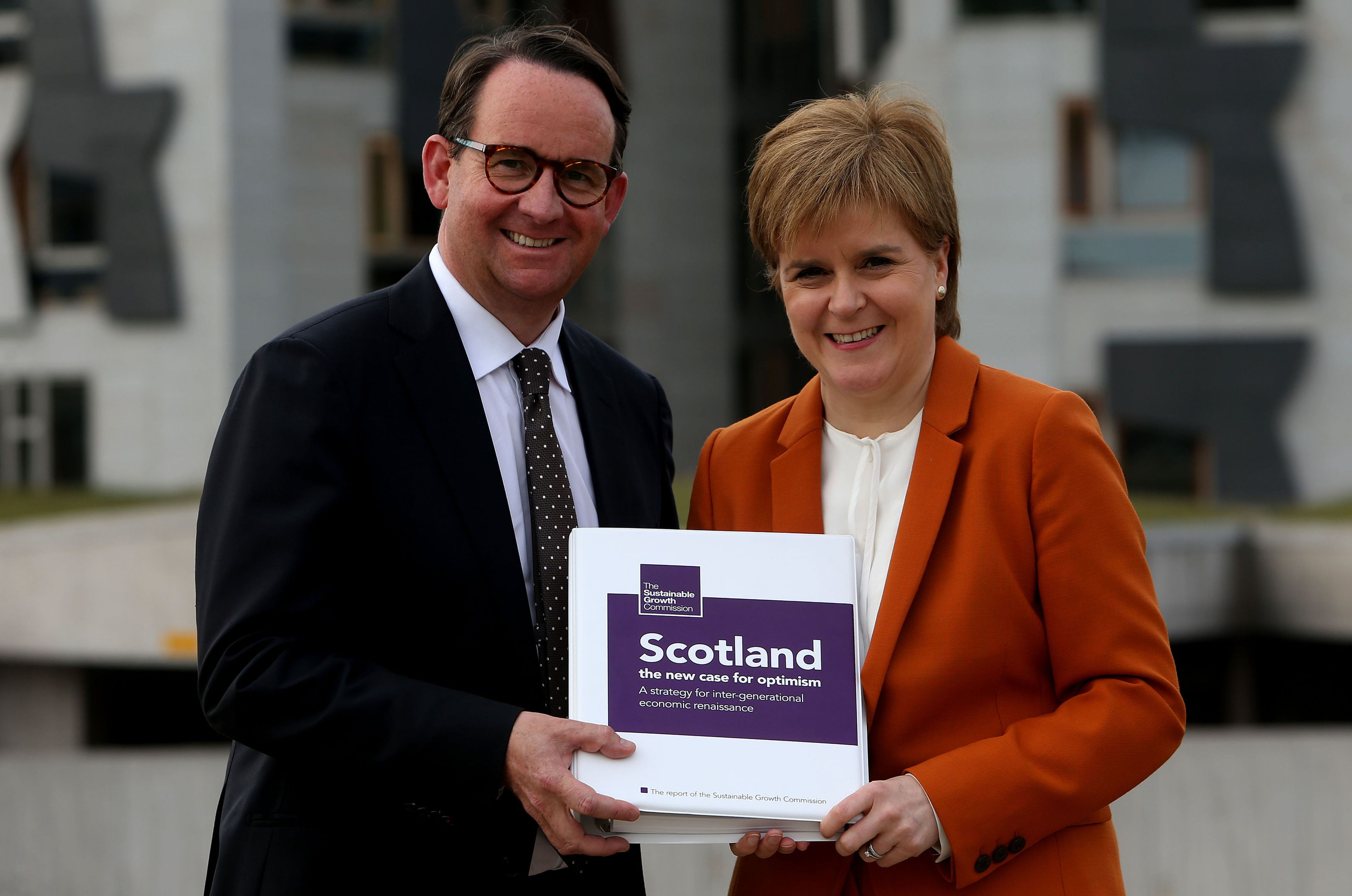 First Minister Nicola Sturgeon receives the Sustainable Growth Commission report from commission chair Andrew Wilson (Gordon Terris/The Herald/PA Wire)