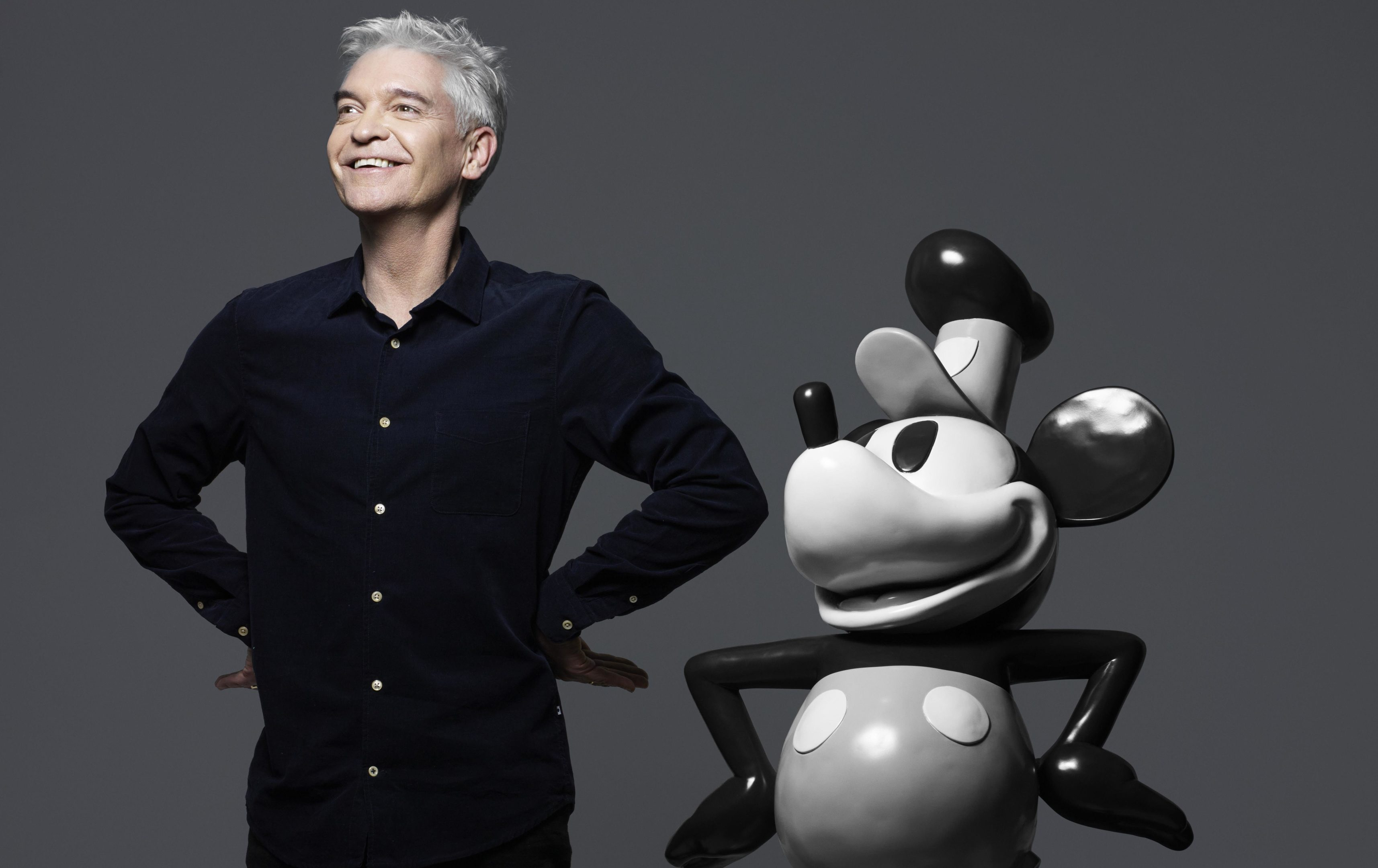 Phillip Schofield poses with Mickey (Rankin/Disney/PA Wire)