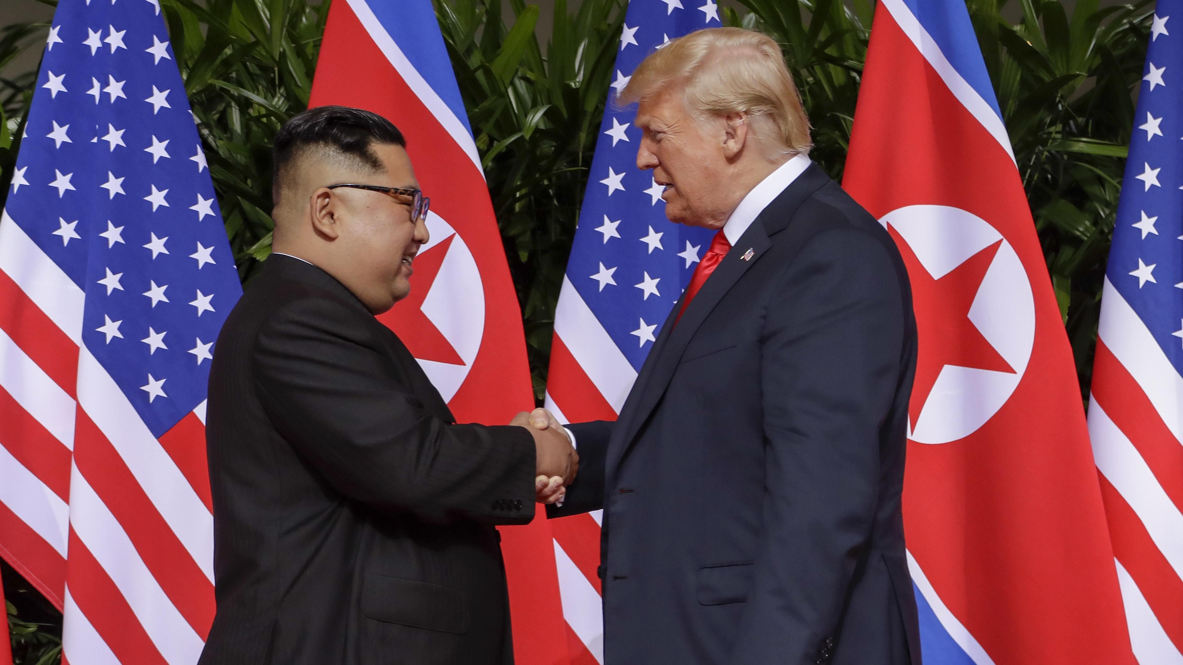 Kim and Trump shake hands