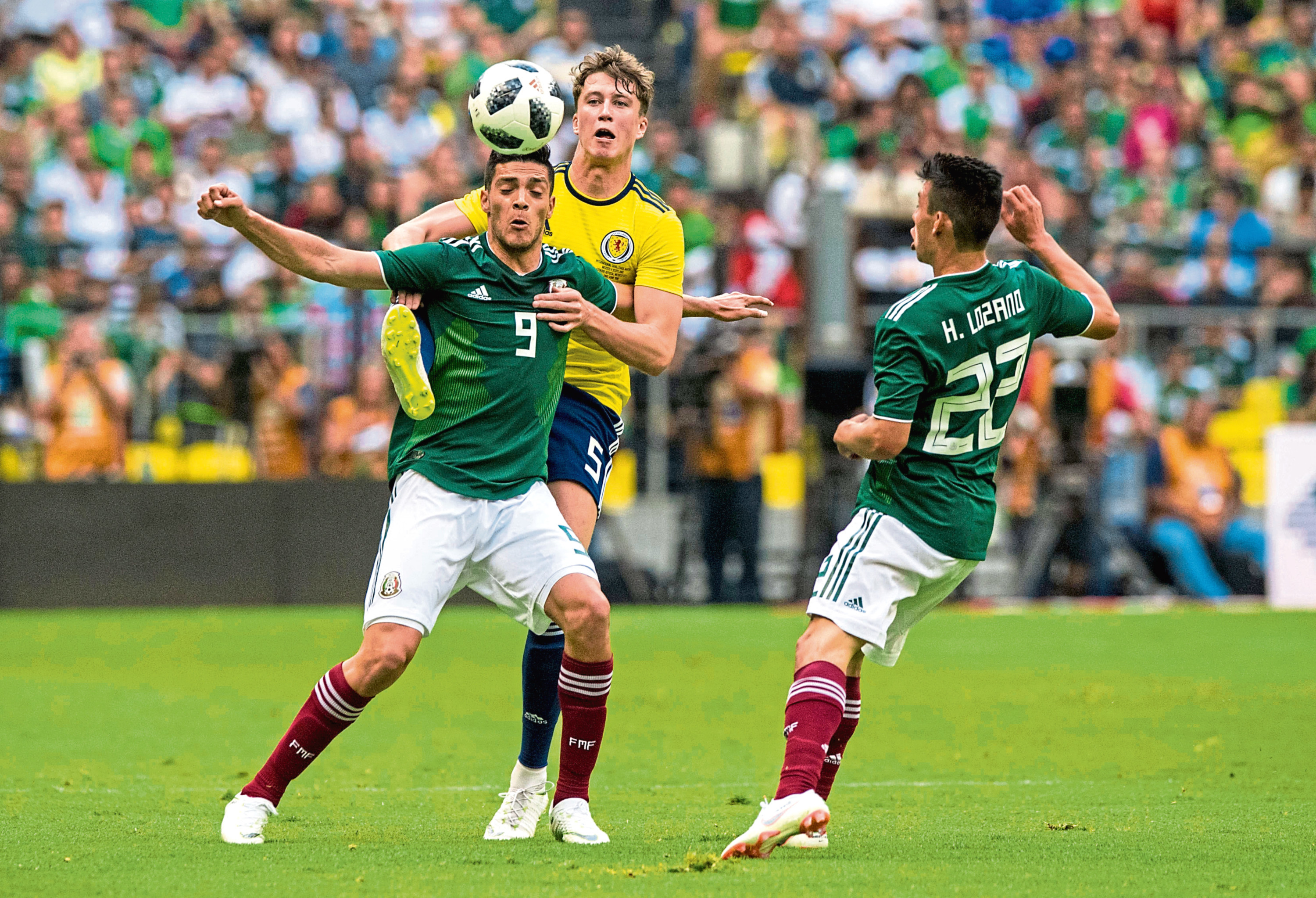 Scotland's Jack Hendry (right) competes with Mexico's Raul Jimenez in a recent friendly (SNS Group / Alan Harvey)