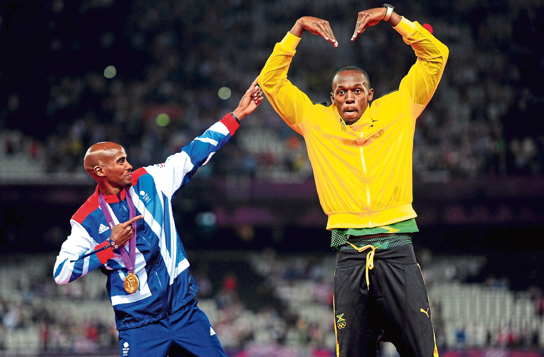 Superstar athletes Mo Farah and Usain Bolt at the 2012 Olympics (Adam Davy / PA)