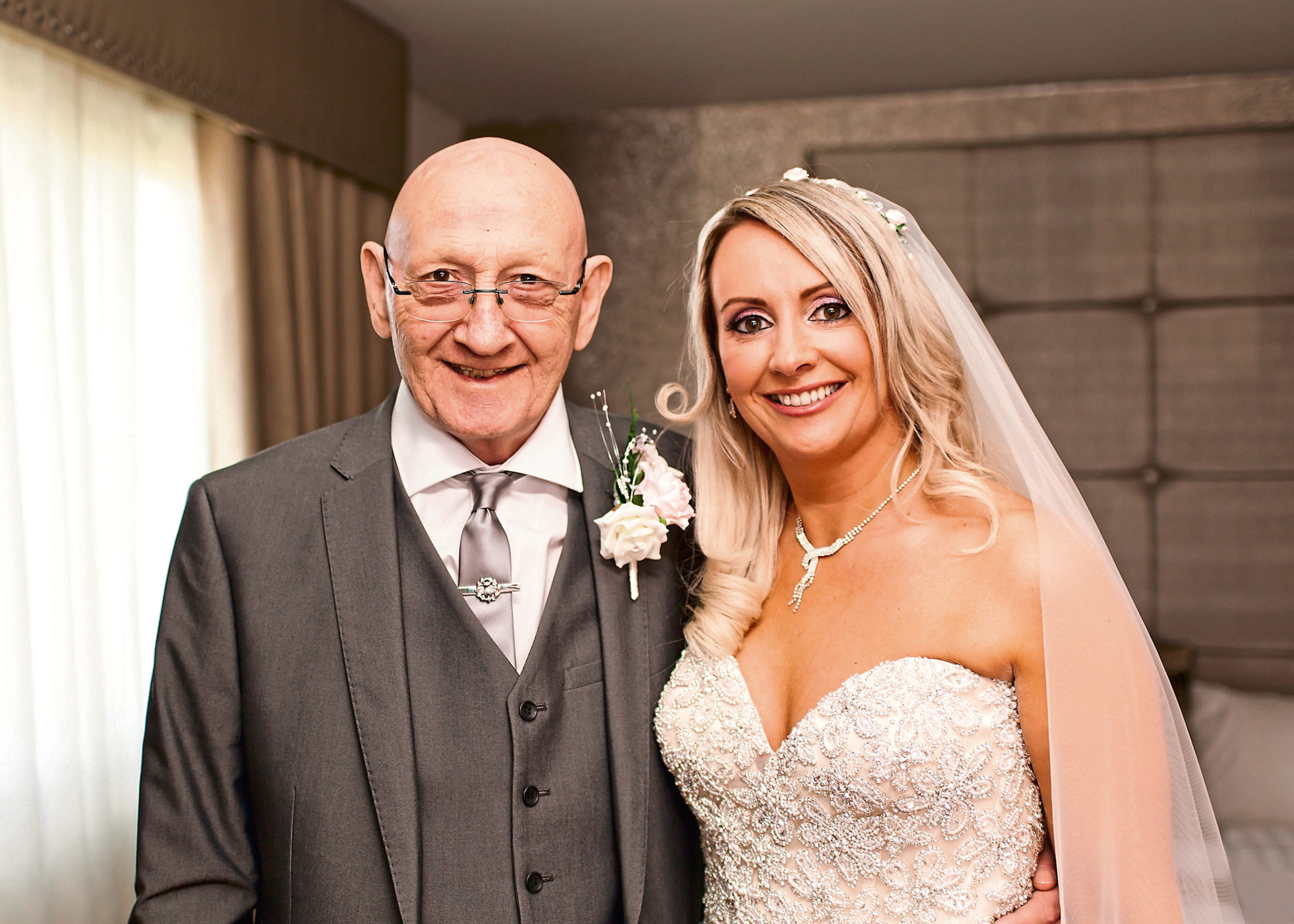 John Hannigan with daughter Claire Hood on her wedding day (Claire Muir Photography)