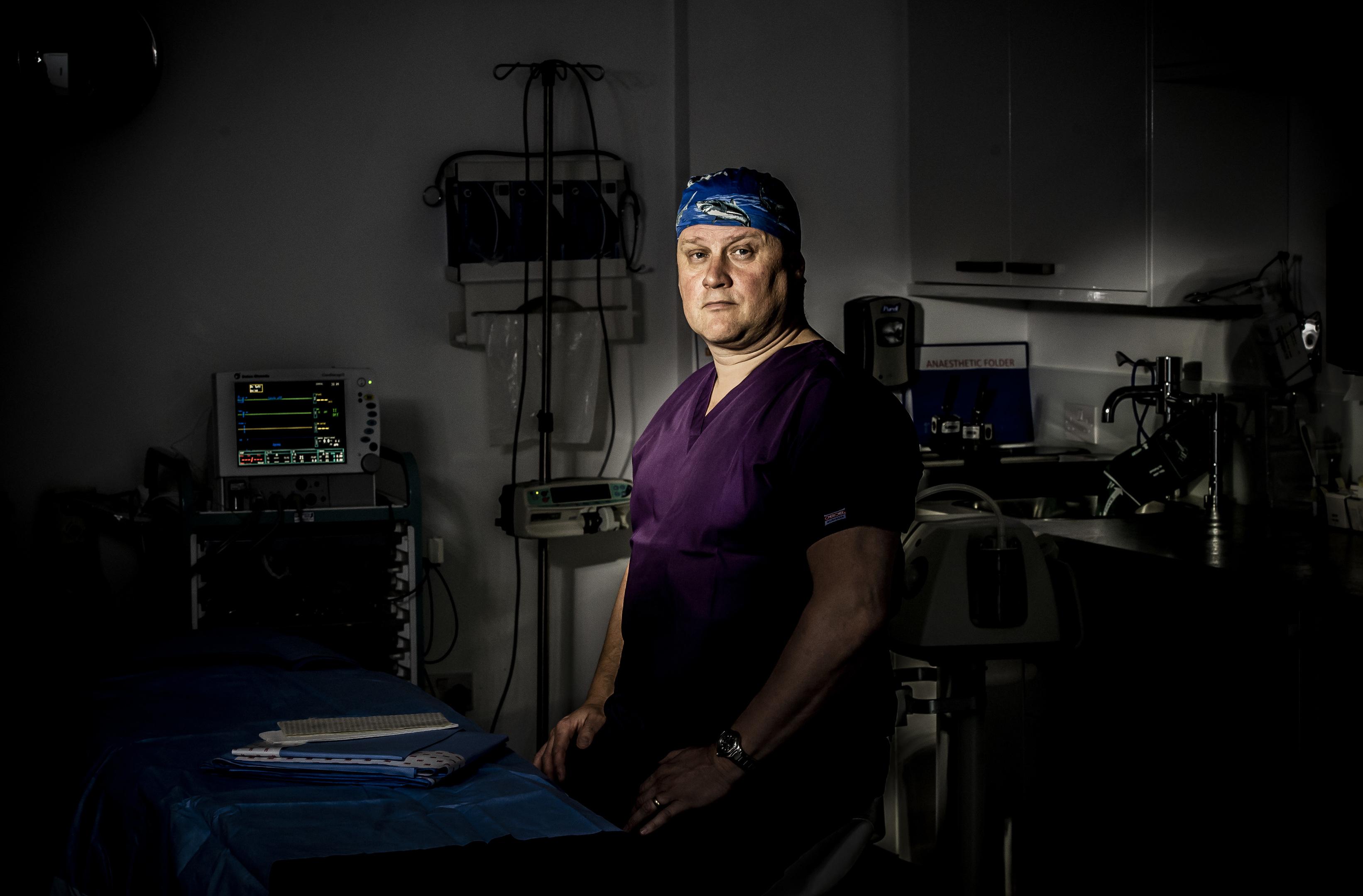 Surgeon Jim McCaul prepares to operate in theatre in Glasgow (Alan Peebles)