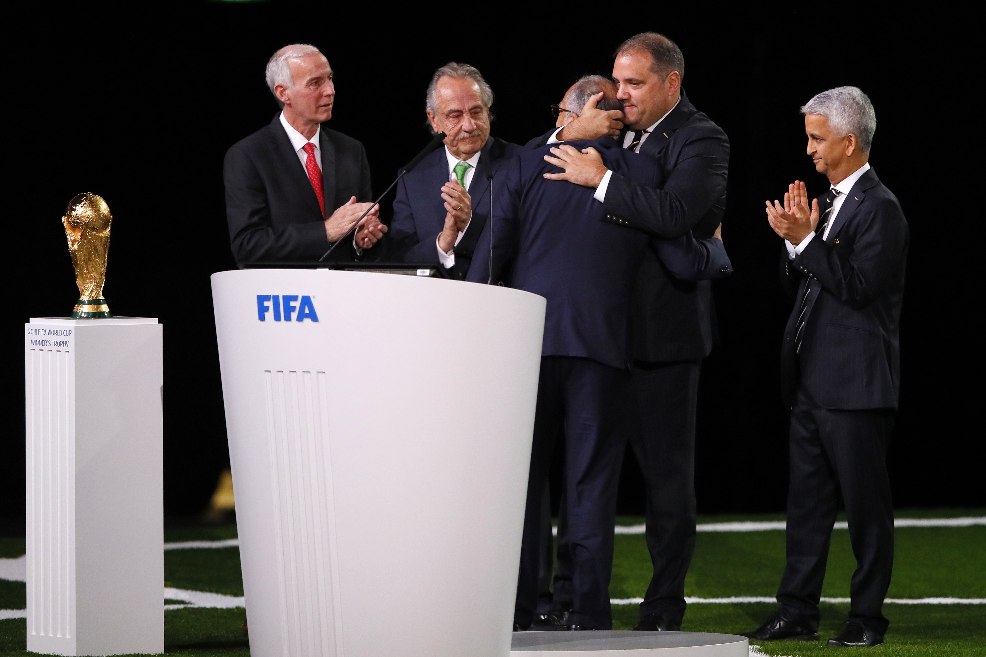 Delegates from the United States, Mexico and Canada celebrate being awarded the World Cup Finals (Kevin C. Cox/Getty Images)