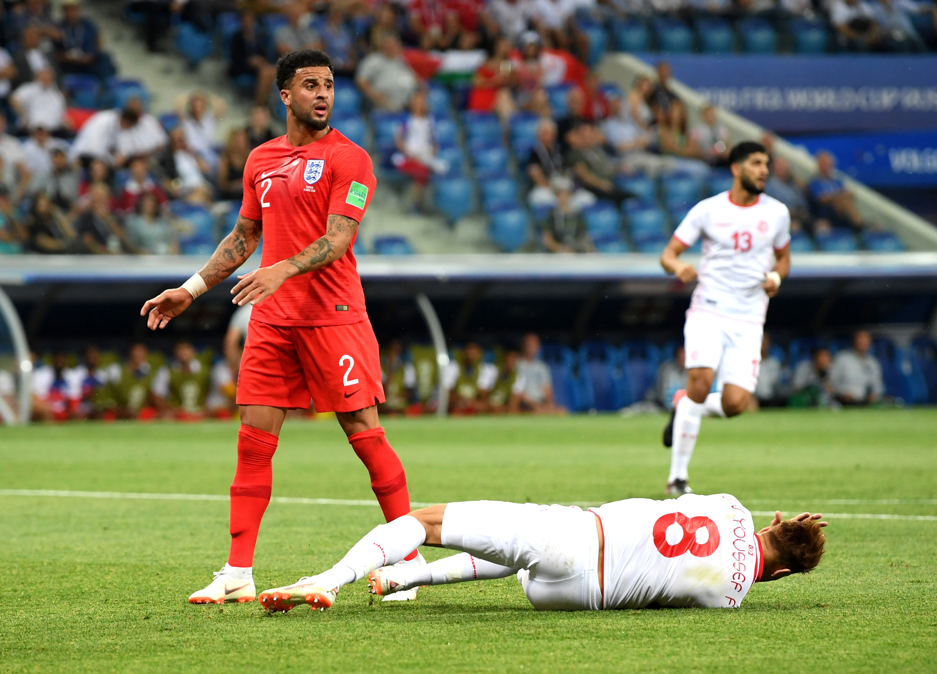 Fakhreddine Ben Youssef of Tunisia goes down in penalty area under challenge from Kyle Walker (Matthias Hangst/Getty Images)