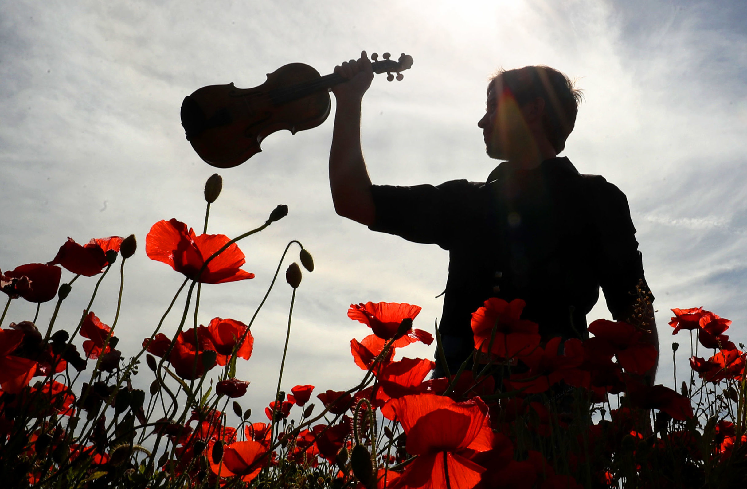 Musician and composer Thoren Ferguson with the Wilfred Owen violin  during the launch of 'Armistice' (Jane Barlow/PA Wire)