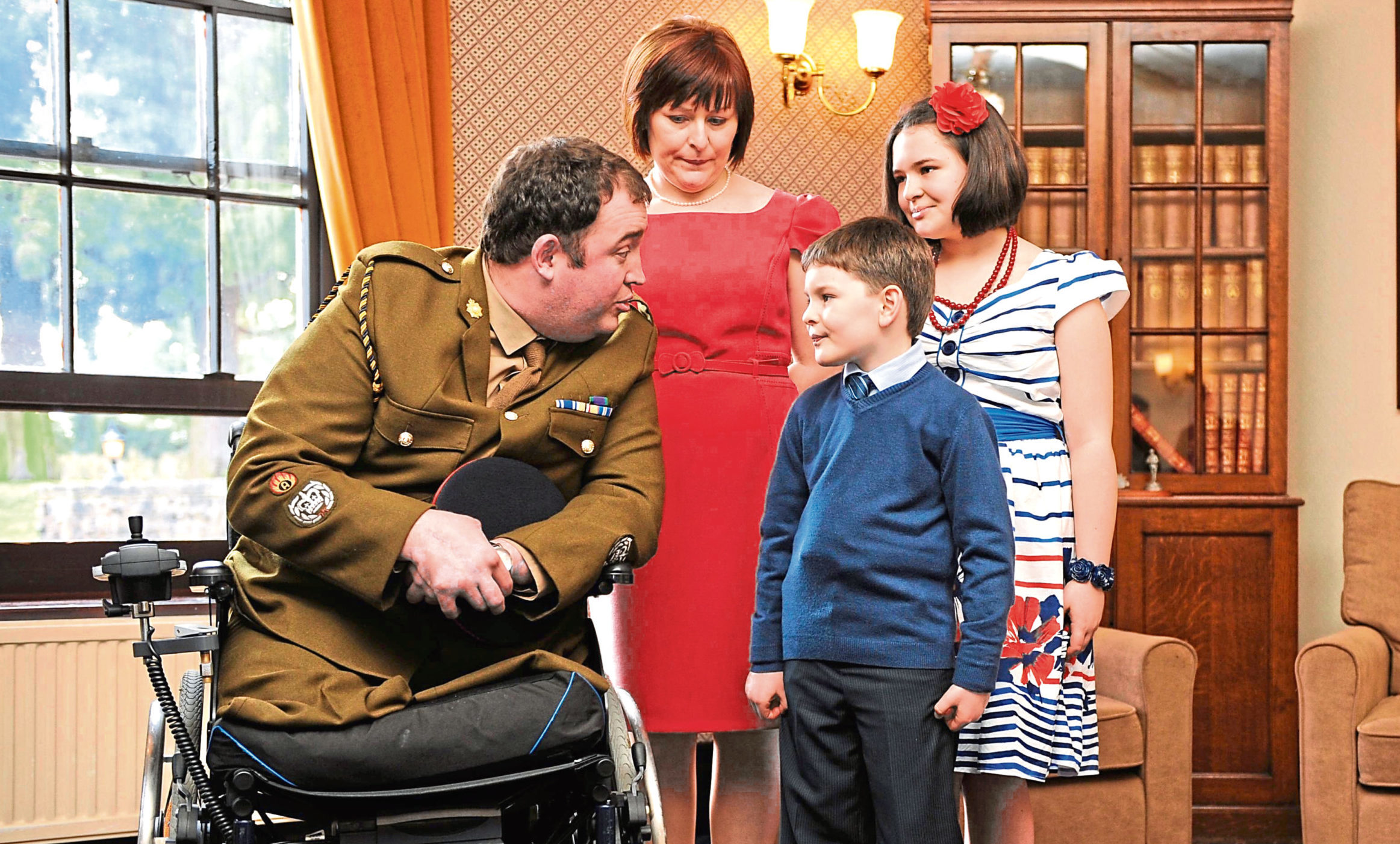 Warrant Officer Ken Bellringer with son Harry, wife Christine and daughter Neeve