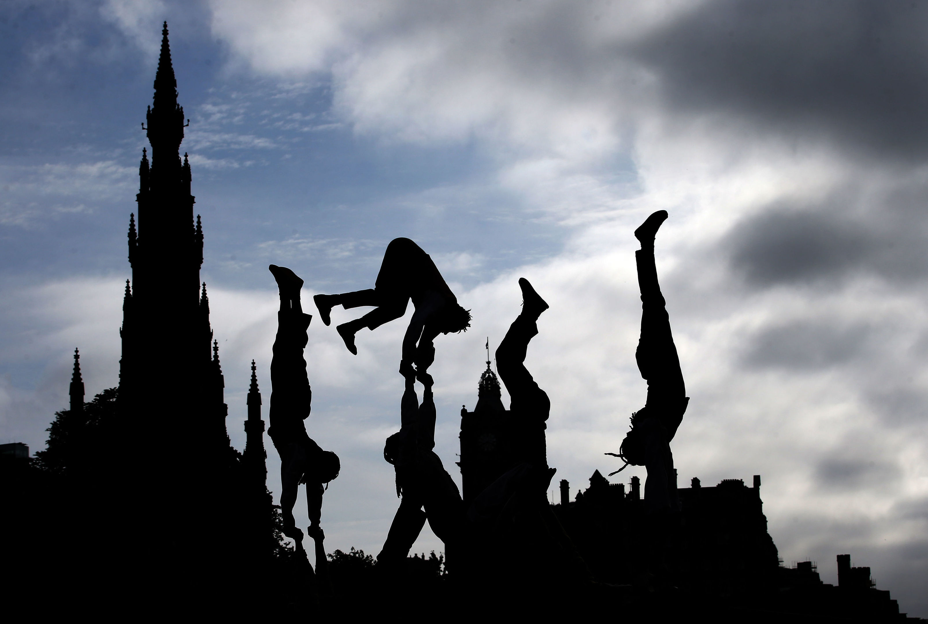 Acrobats from Cirque Berserk perform on the streets of Edinburgh to help launch the Edinburgh Festival Fringe 2018, ahead of their festival debut.  (Jane Barlow/PA Wire)