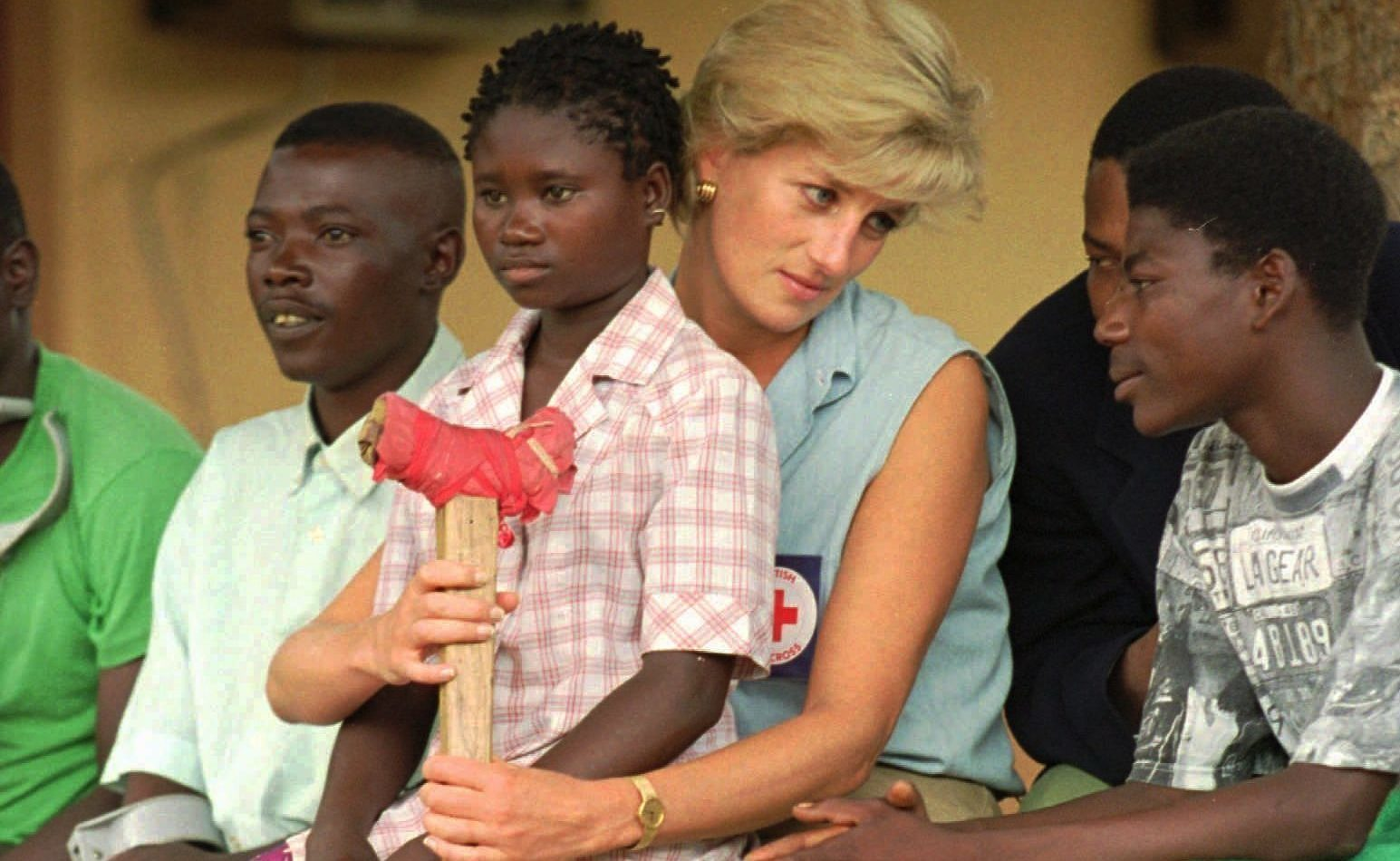 Diana, Princess of Wales, talks to amputees, at the the Neves Bendinha Orthopedic Workshop on the outskirts of Luanda. Joao Silva/AP