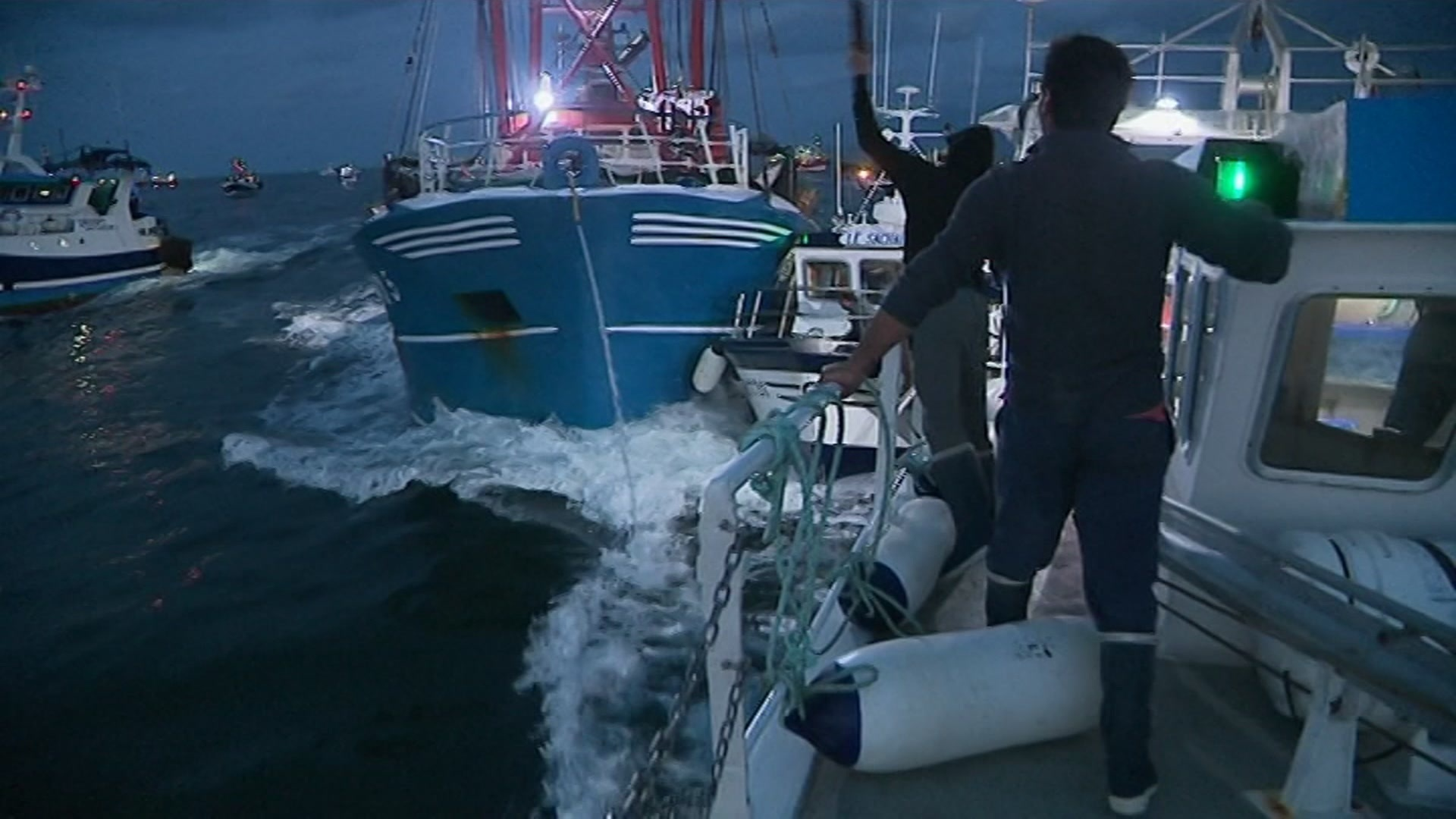 In this image taken from France 3 video, French and British boats clash off France's northern coast (France 3 via AP)