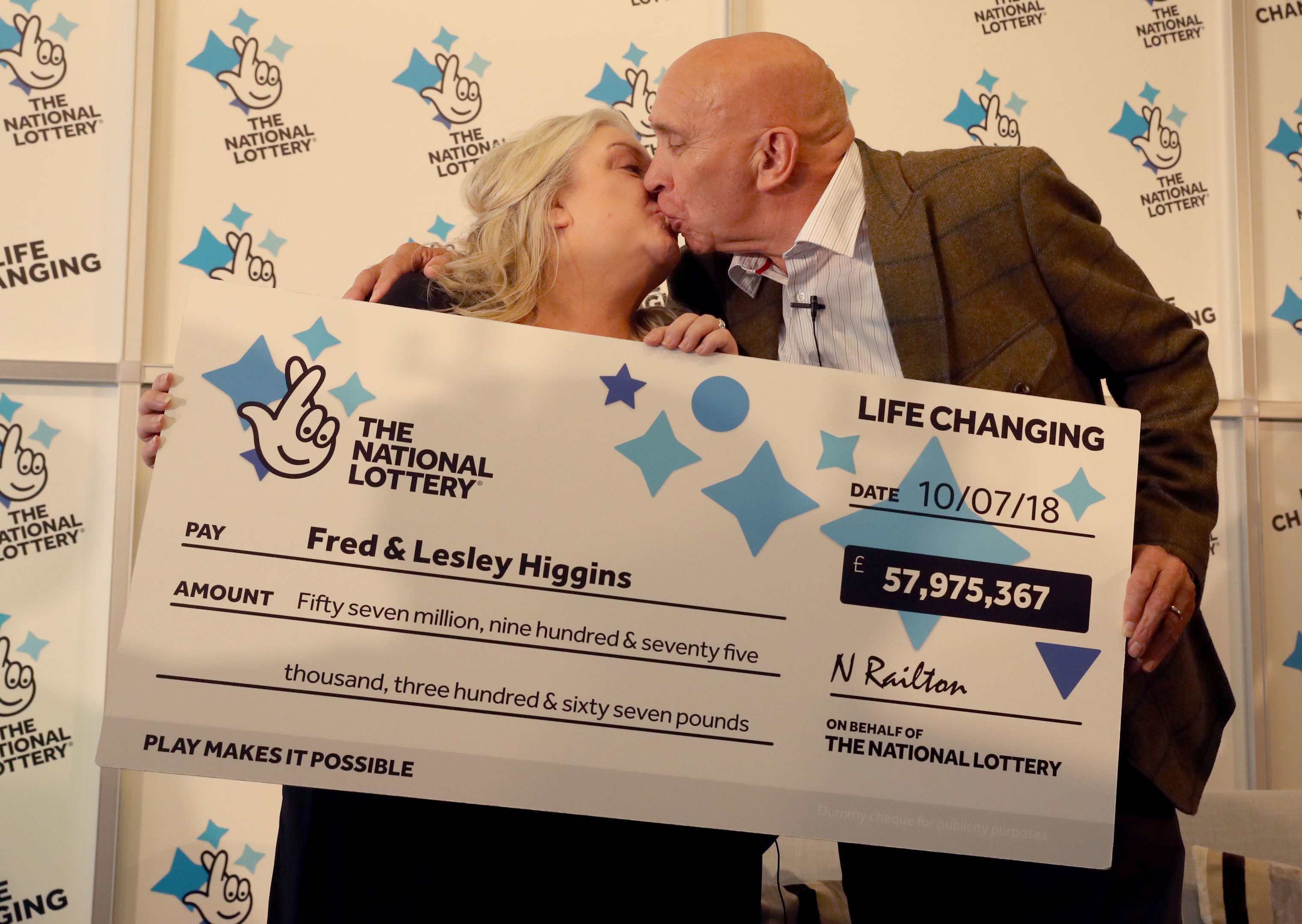 Retired couple Fred and Lesley Higgins from Laurencekirk, Aberdeenshire celebrate after winning £57.9 million on the National Lottery EuroMillions draw.  (Andrew Milligan/PA Wire)