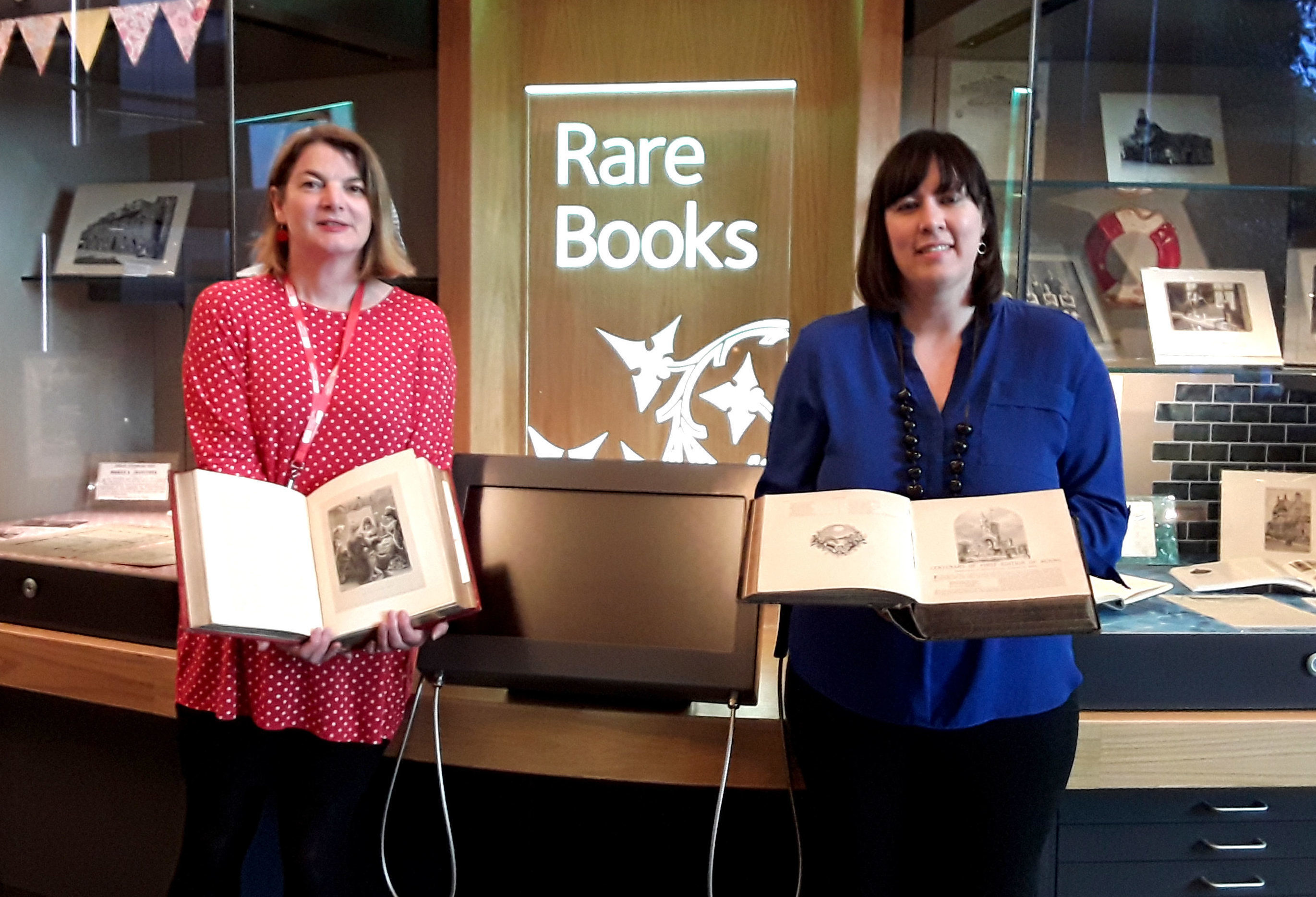 Sara Ann Kelly, Local Studies Officer at ONFife Archive (left) and author Cassie Kennedy holding copies of a historic book on Robert Burns (Fife Council/PA Wire)