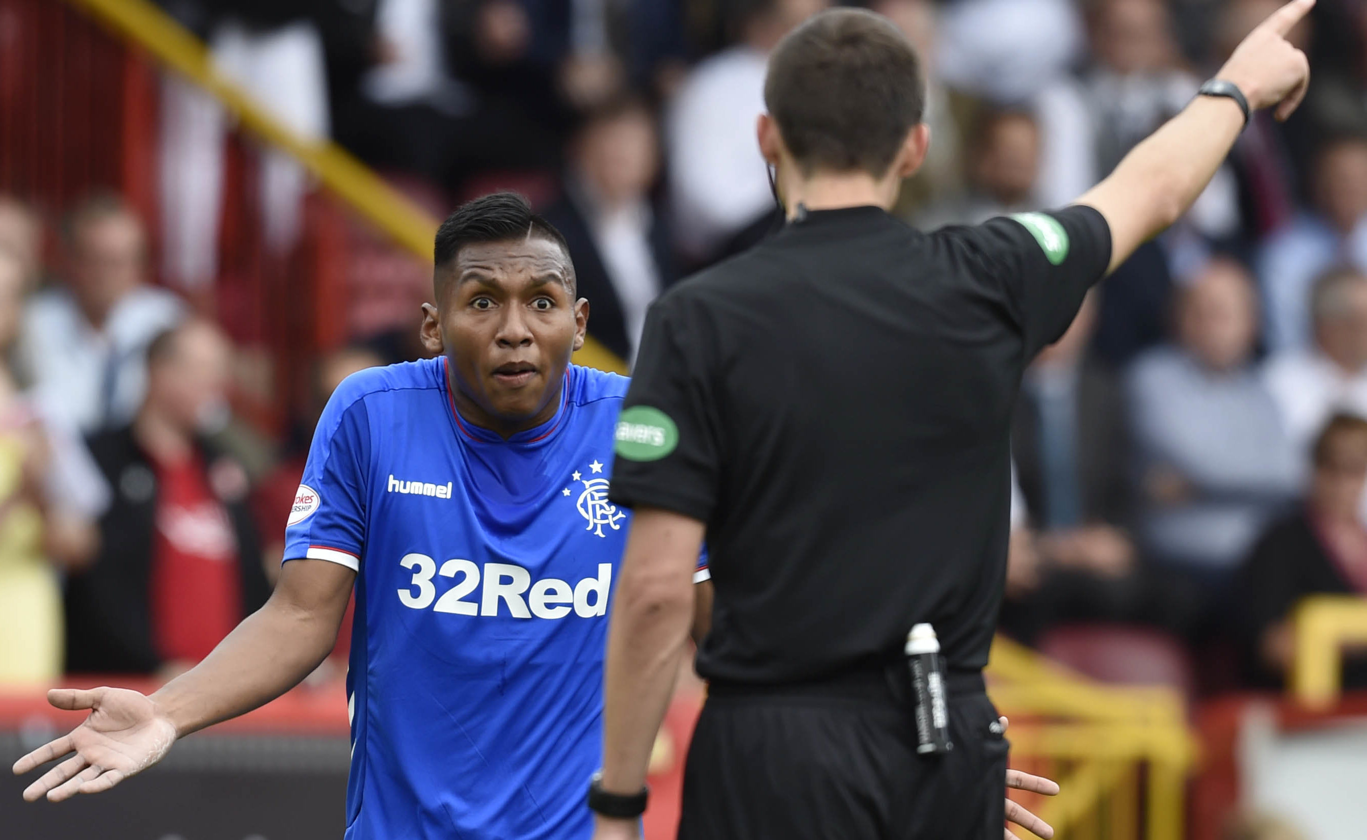 Rangers' Alfredo Morelos is shown a red card by Kevin Clancy in Sunday's match (SNS Group)